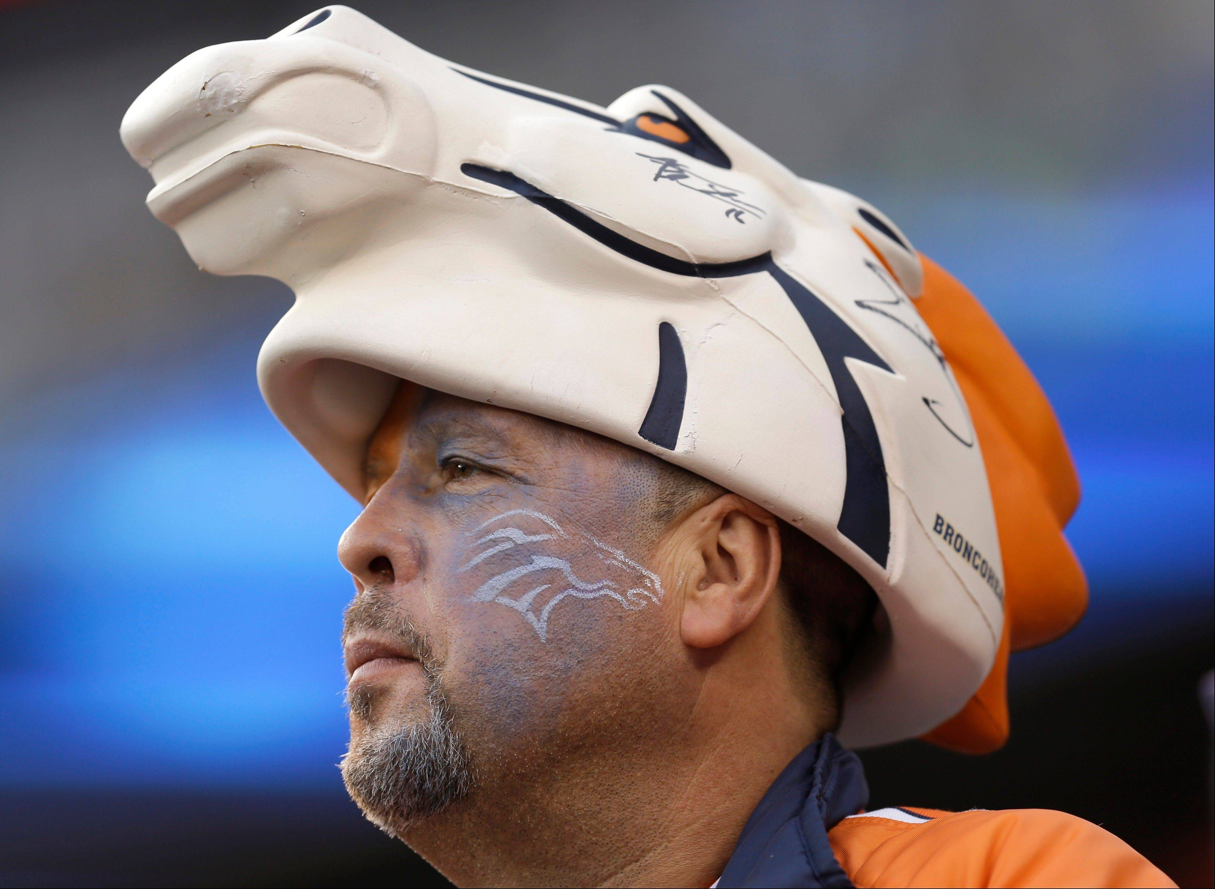 Steve Liedtke, of Denver, wears Denver Broncos head gear before the NFL Super Bowl XLVIII football game between the Seattle Seahawks and the Denver Broncos.