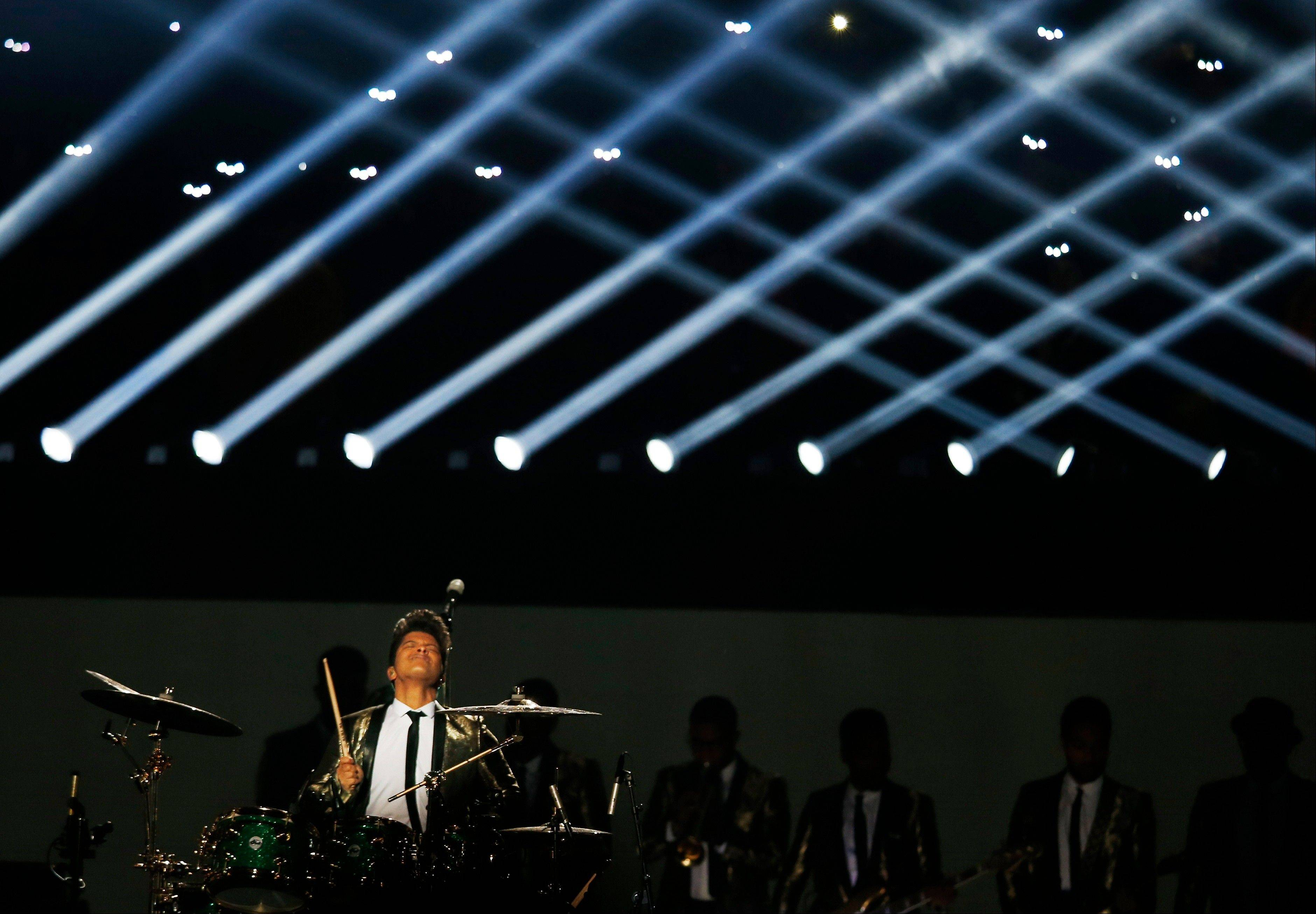 Bruno Mars performs during the halftime show of the NFL Super Bowl XLVIII football game between the Seattle Seahawks and the Denver Broncos Sunday, Feb. 2, 2014, in East Rutherford, N.J.