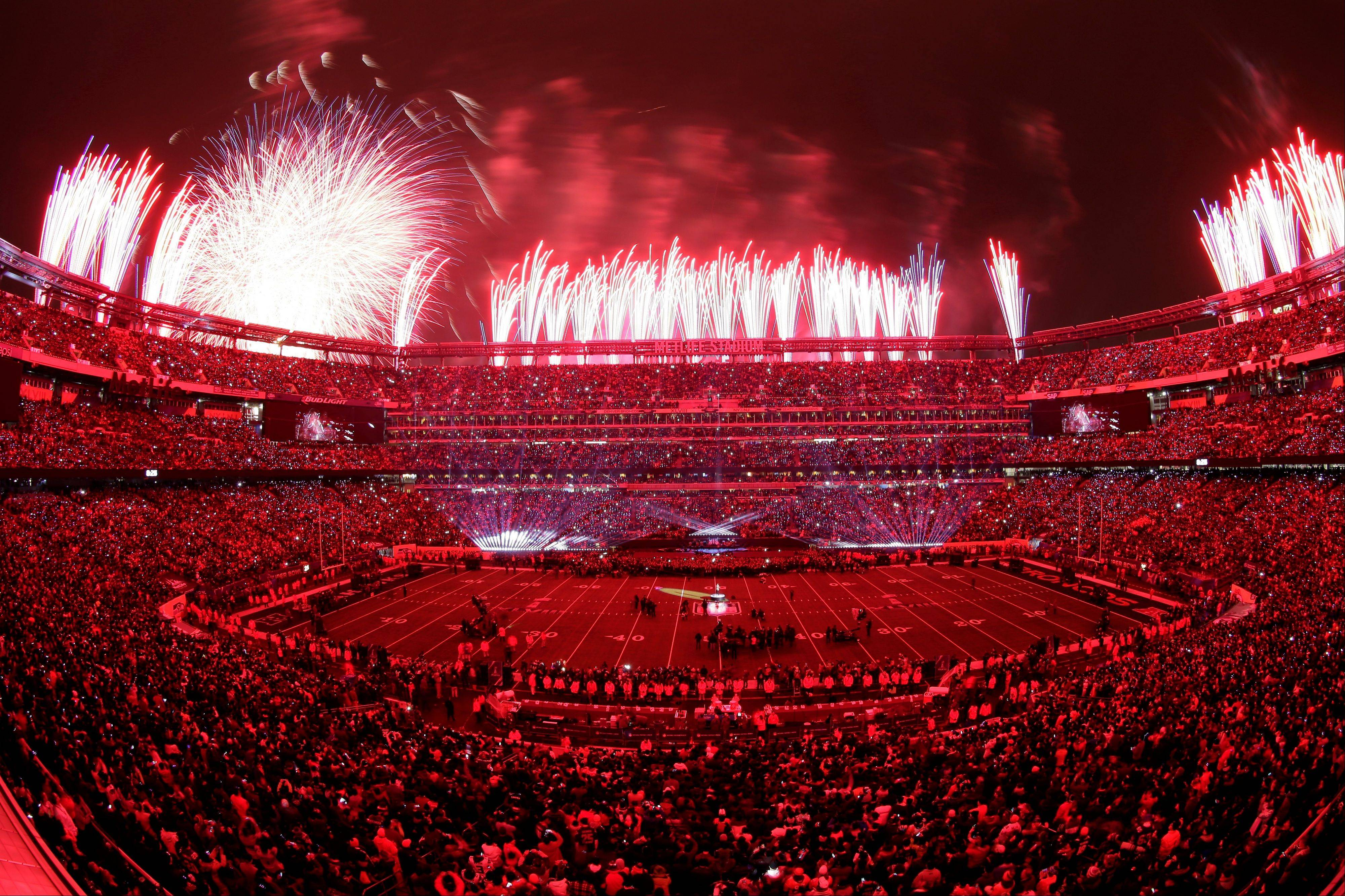 Fans watch a pyrotechnics display during the halftime show of the NFL Super Bowl XLVIII football game.