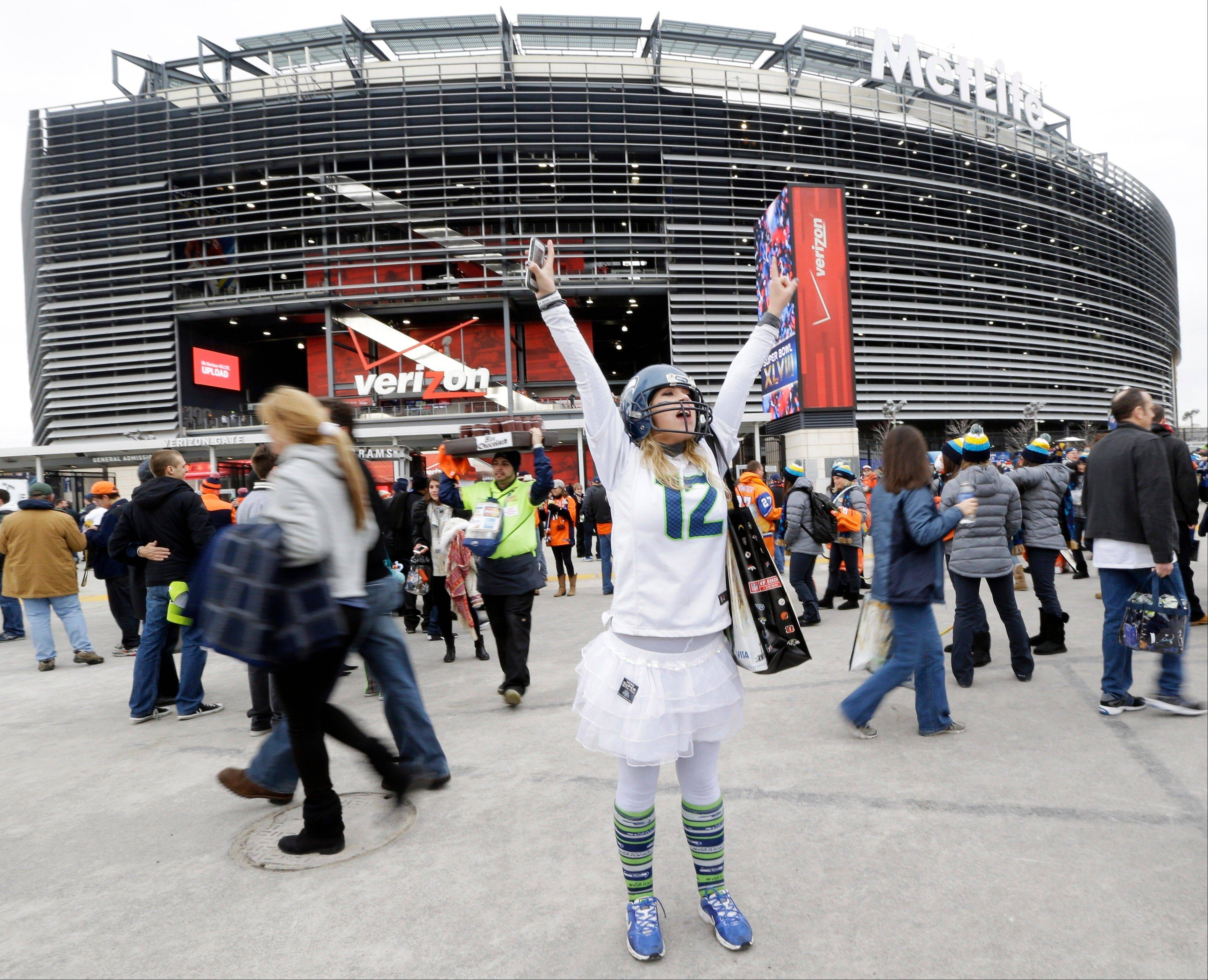 Lacey Surprenat of Seattle cheers outside MetLife Stadium before the NFL Super Bowl XLVIII football game.