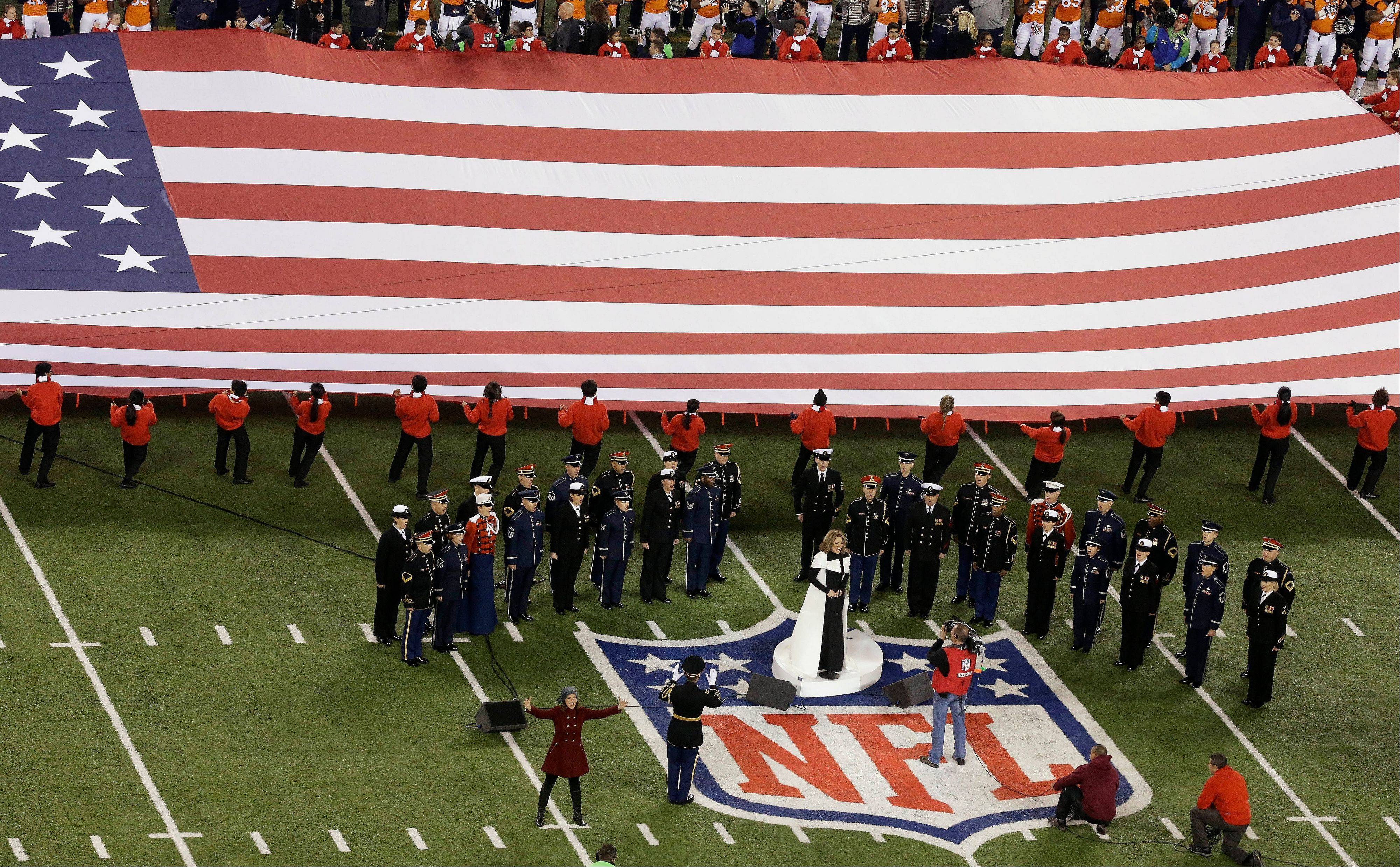 Opera singer Ren�e Fleming sings the national anthem before the NFL Super Bowl XLVIII football game.