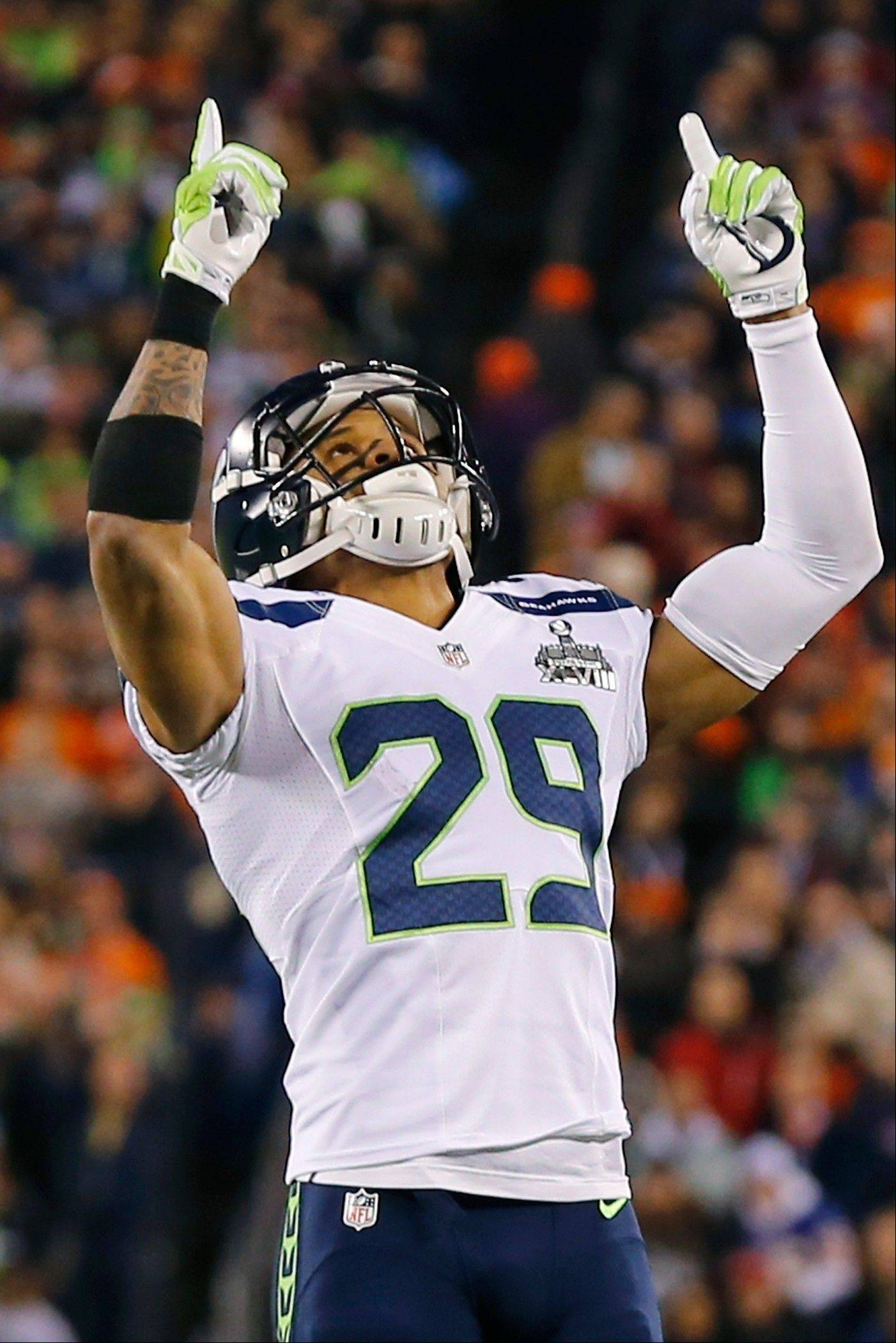 Seattle Seahawks' Earl Thomas celebrates a safety during the first half.