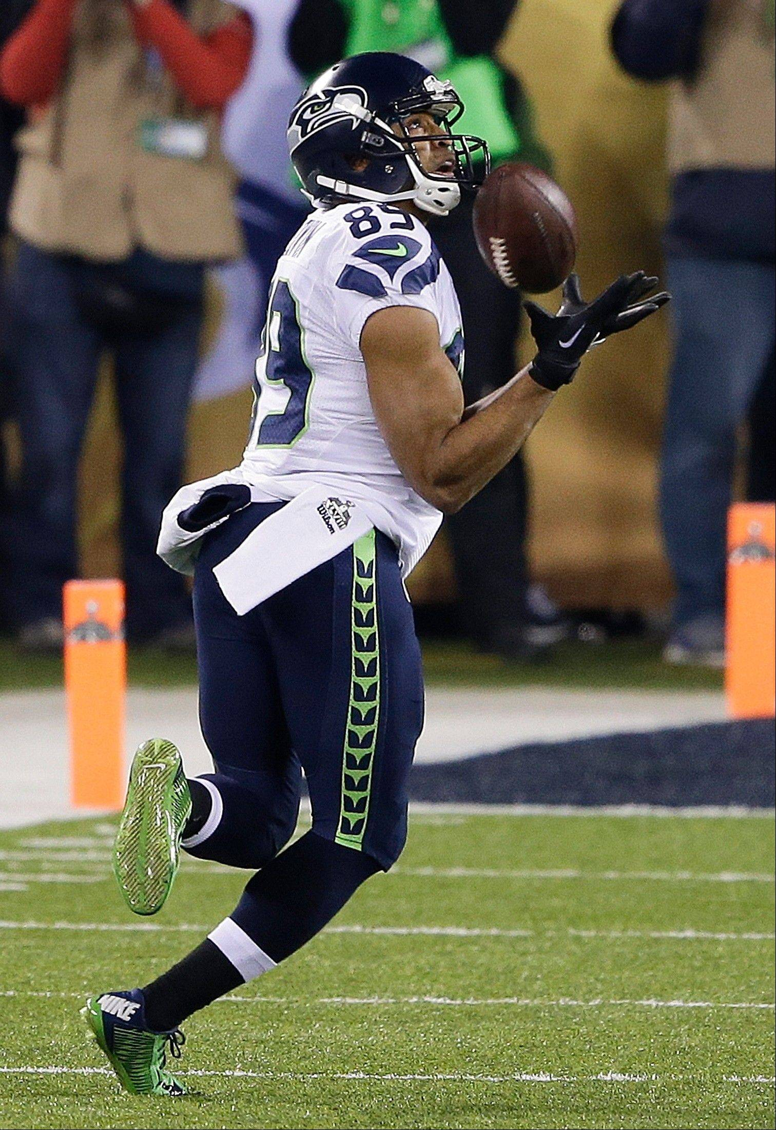 Seattle Seahawks wide receiver Doug Baldwin makes a catch during the first half of the NFL Super Bowl XLVIII football game.