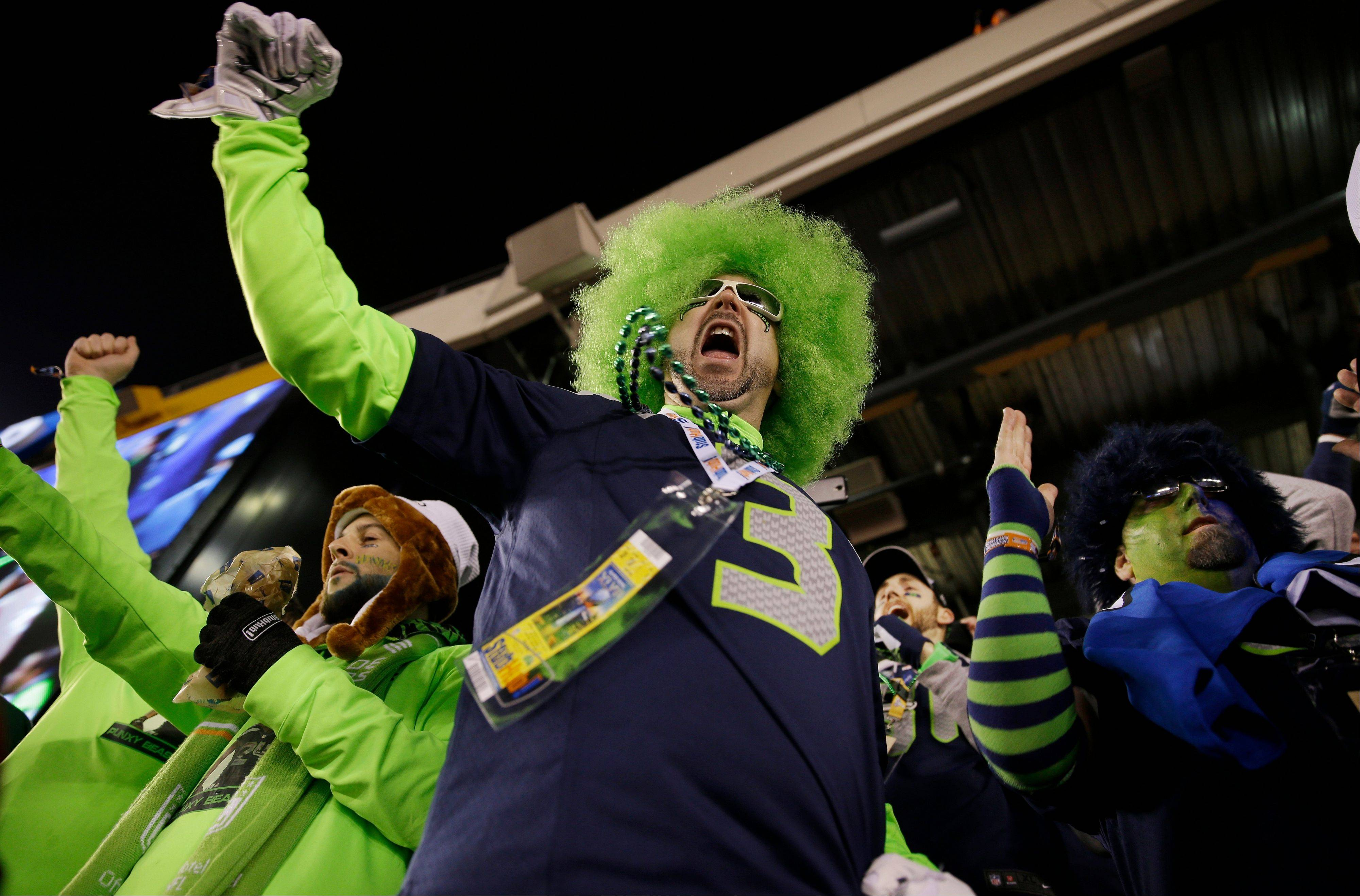 A Seattle Seahawks fan cheers during the first half the NFL Super Bowl XLVIII football game.