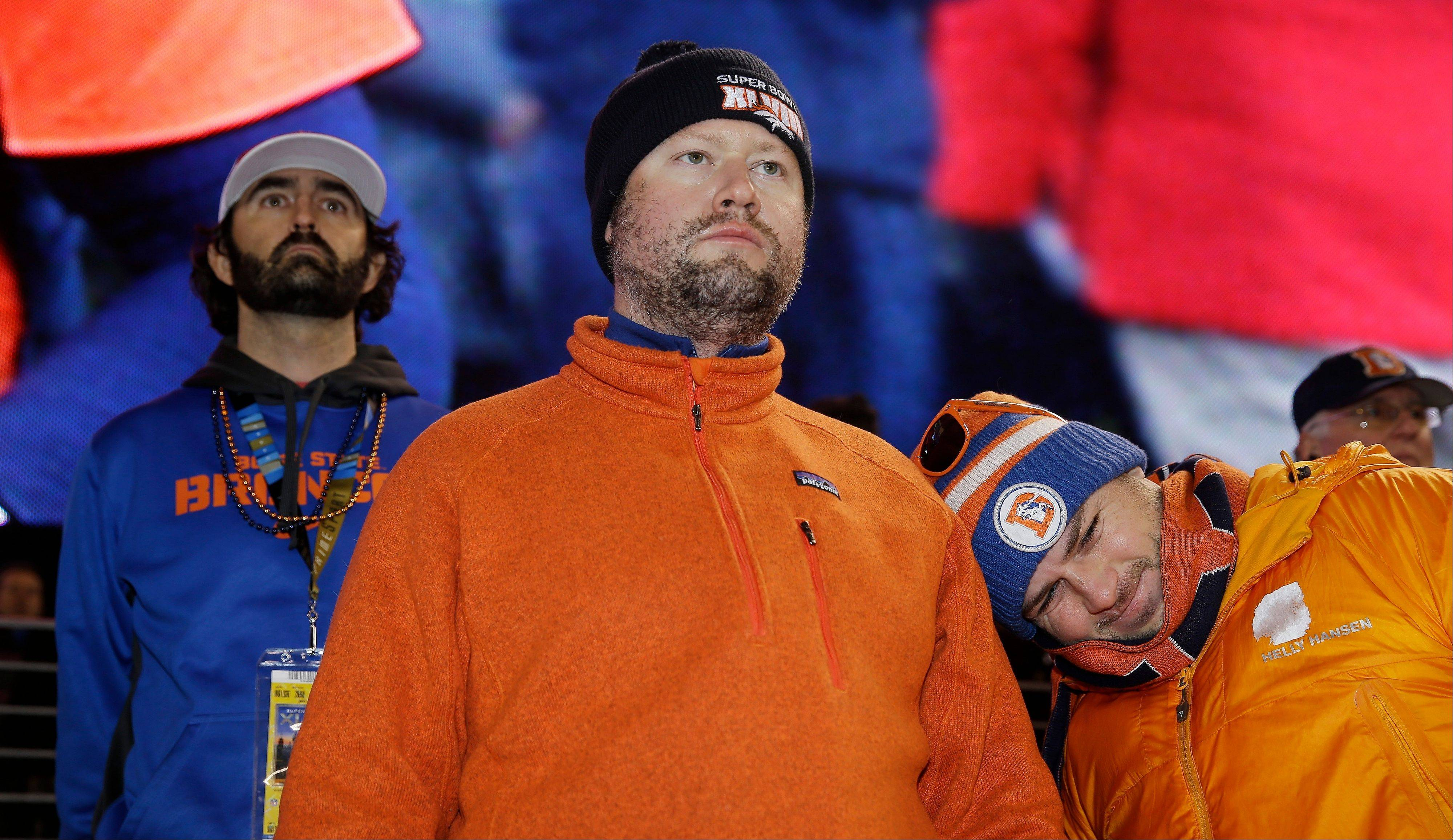 Denver Broncos fans watch play against the Seattle Seahawks during the first half.