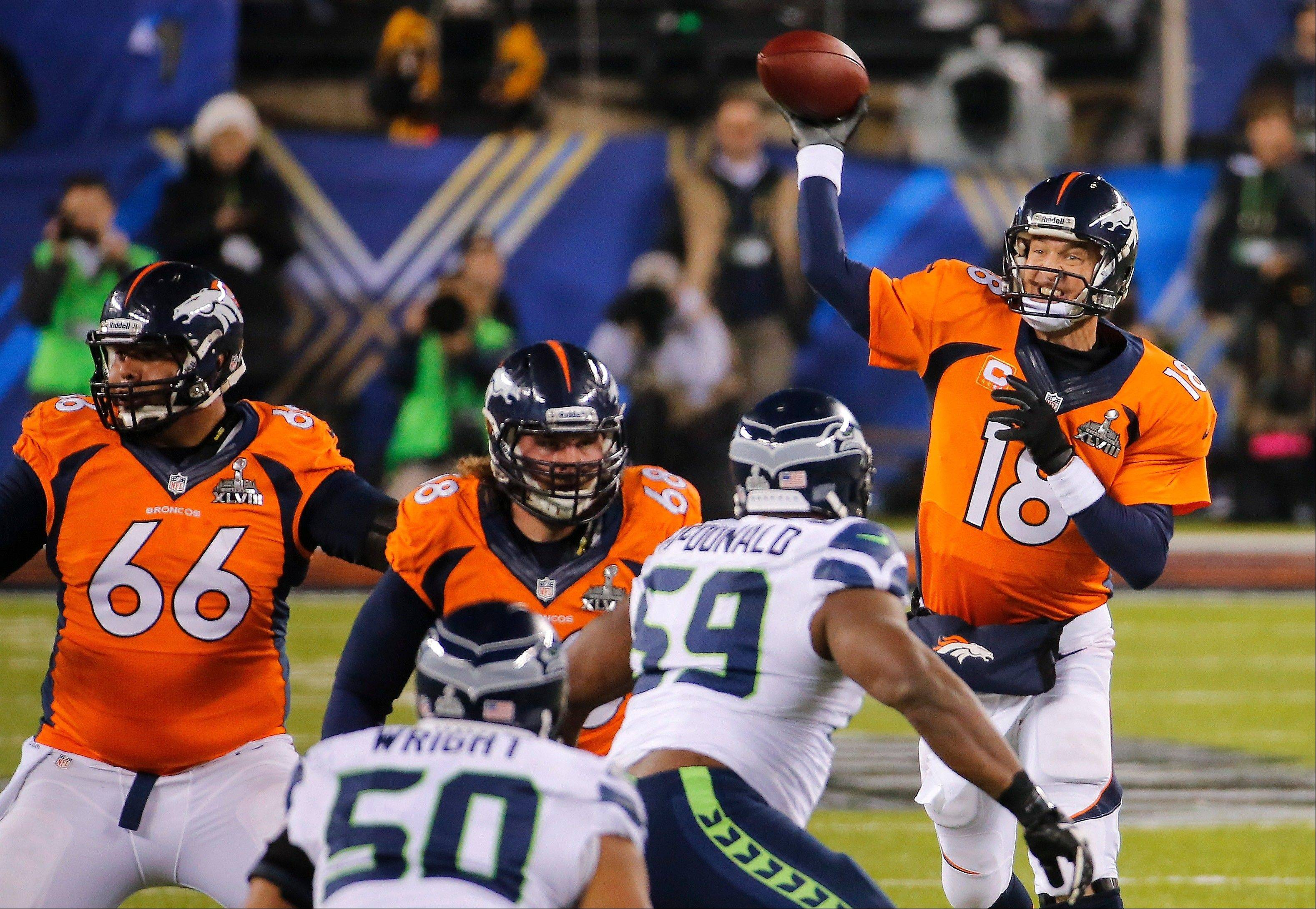 Denver Broncos quarterback Peyton Manning (18) throws a pass against the Seattle Seahawks during the first half.