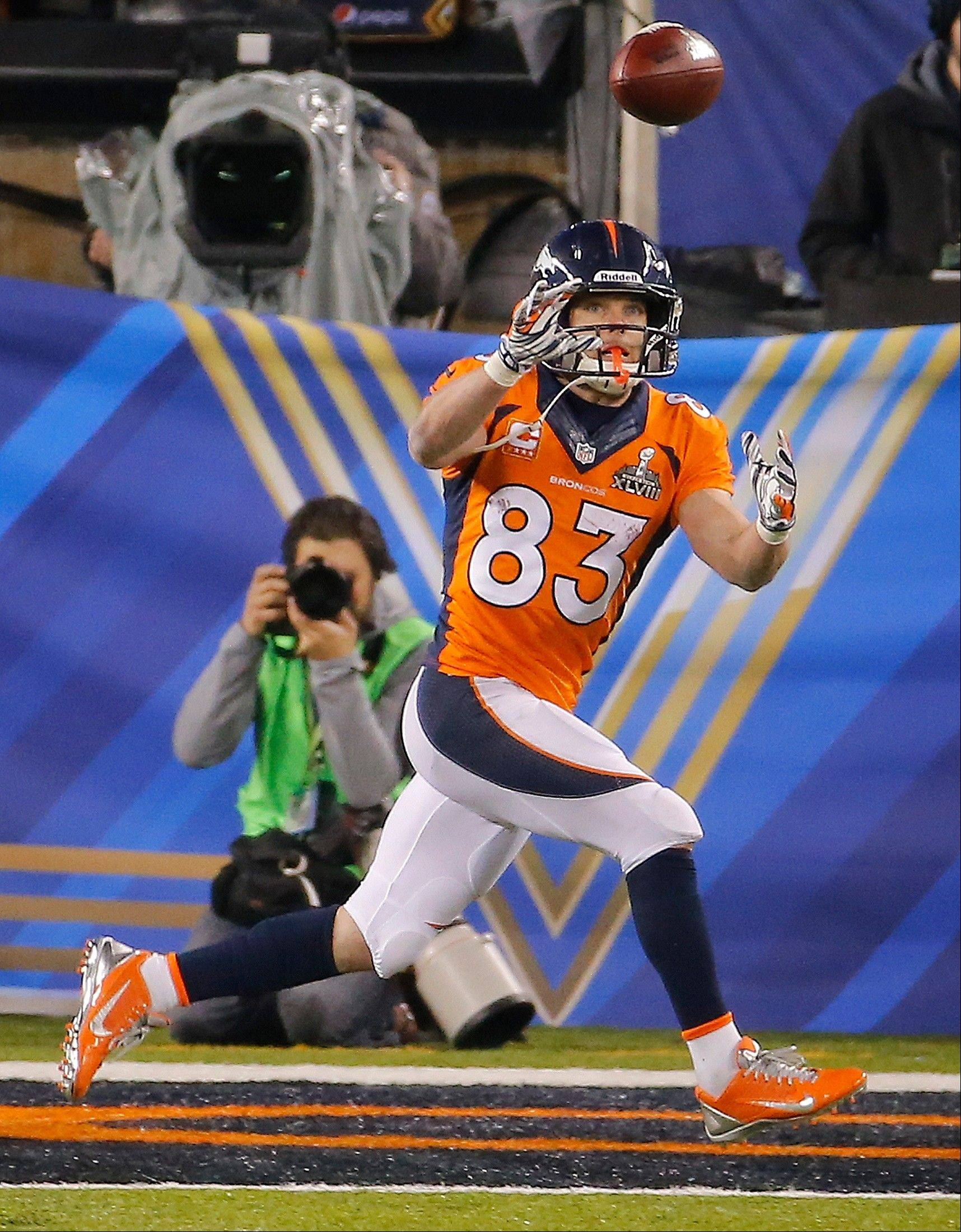 Denver Broncos wide receiver Wes Welker (83) makes a catch for a two-point conversion during the second half.