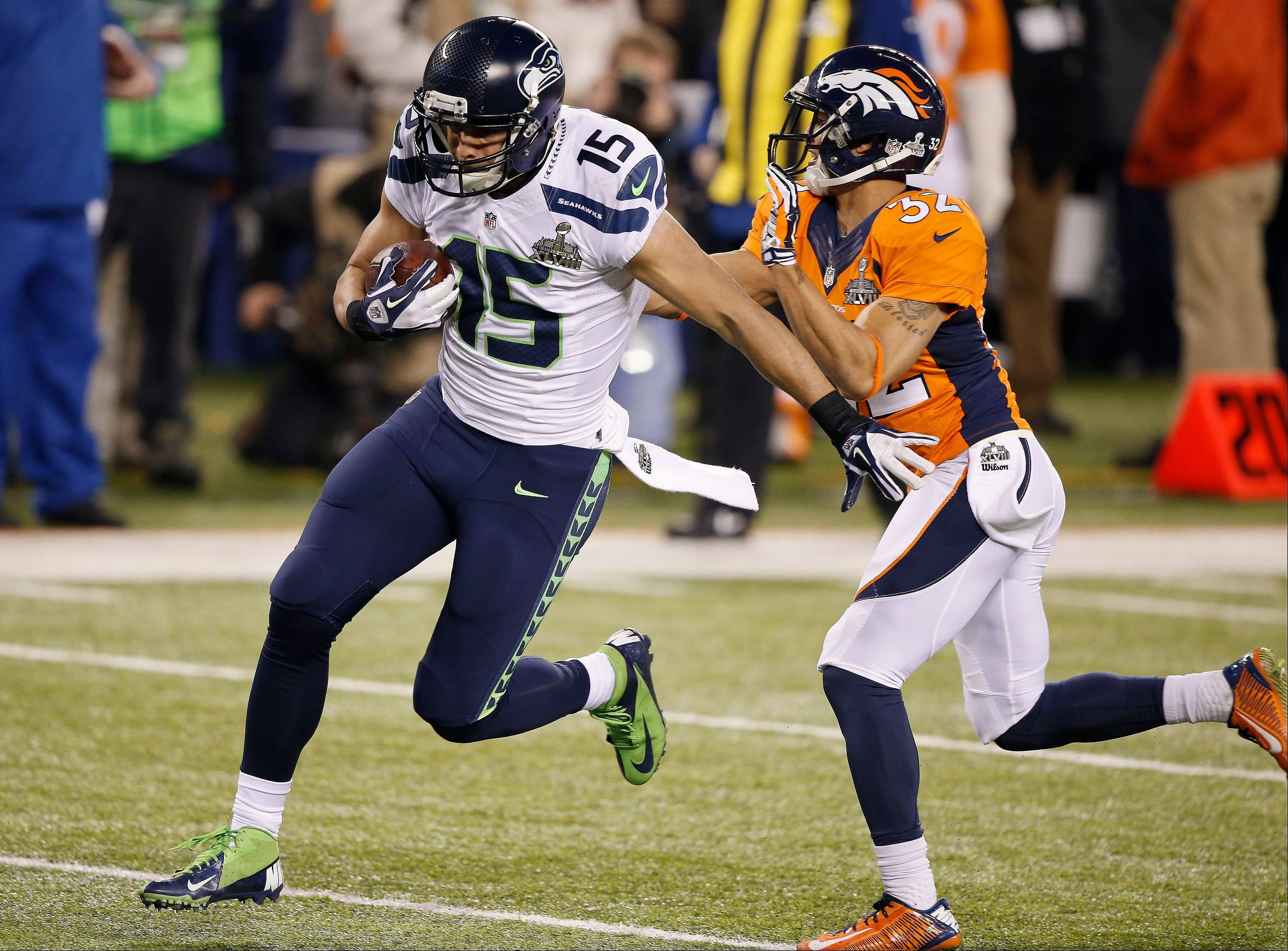 Denver Broncos cornerback Tony Carter (32) misses a tackle as Seattle Seahawks' Jermaine Kearse (15) runs for a touchdown during the second half.