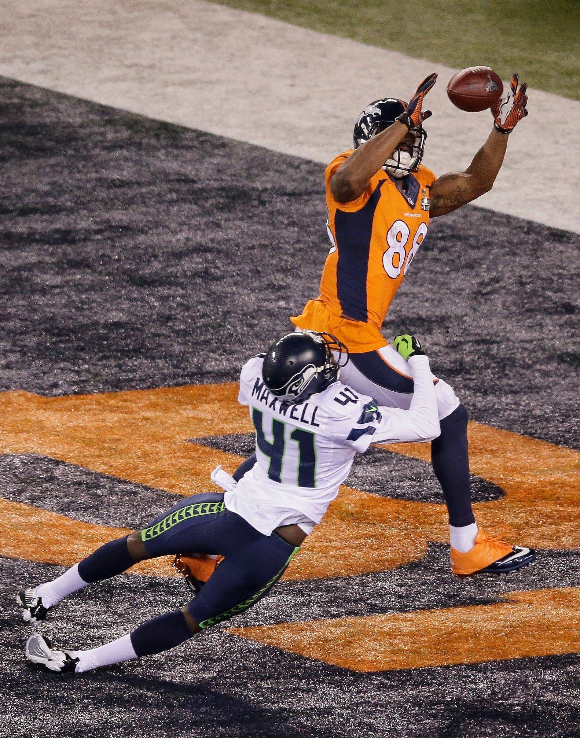 Denver Broncos' Demaryius Thomas makes the catch for a touchdown against Seattle Seahawks' Byron Maxwell during the second half.