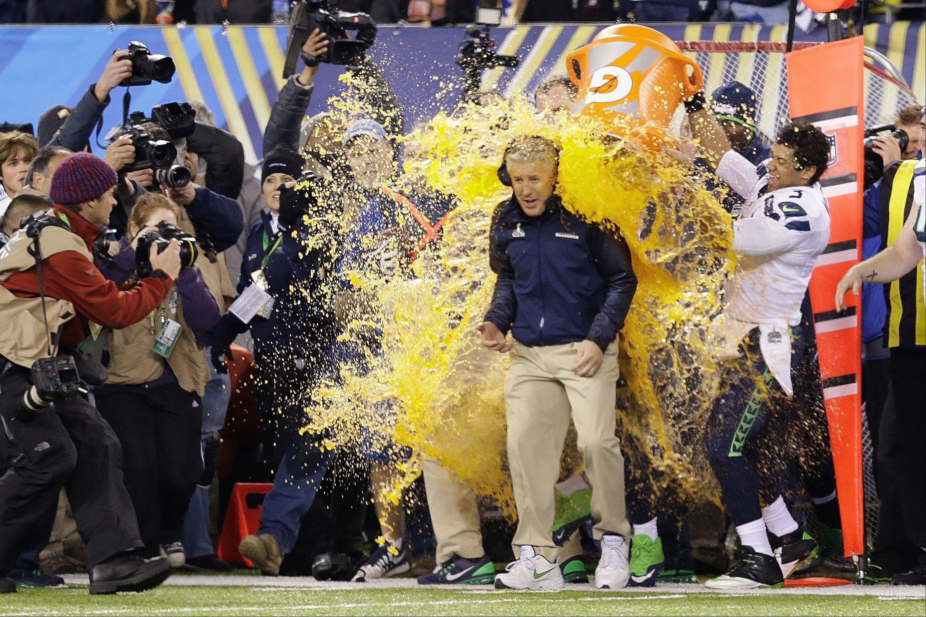 Seattle Seahawks head coach Pete Carroll is doused with Gatorade late in the second half. The Seahawks won 43-8.