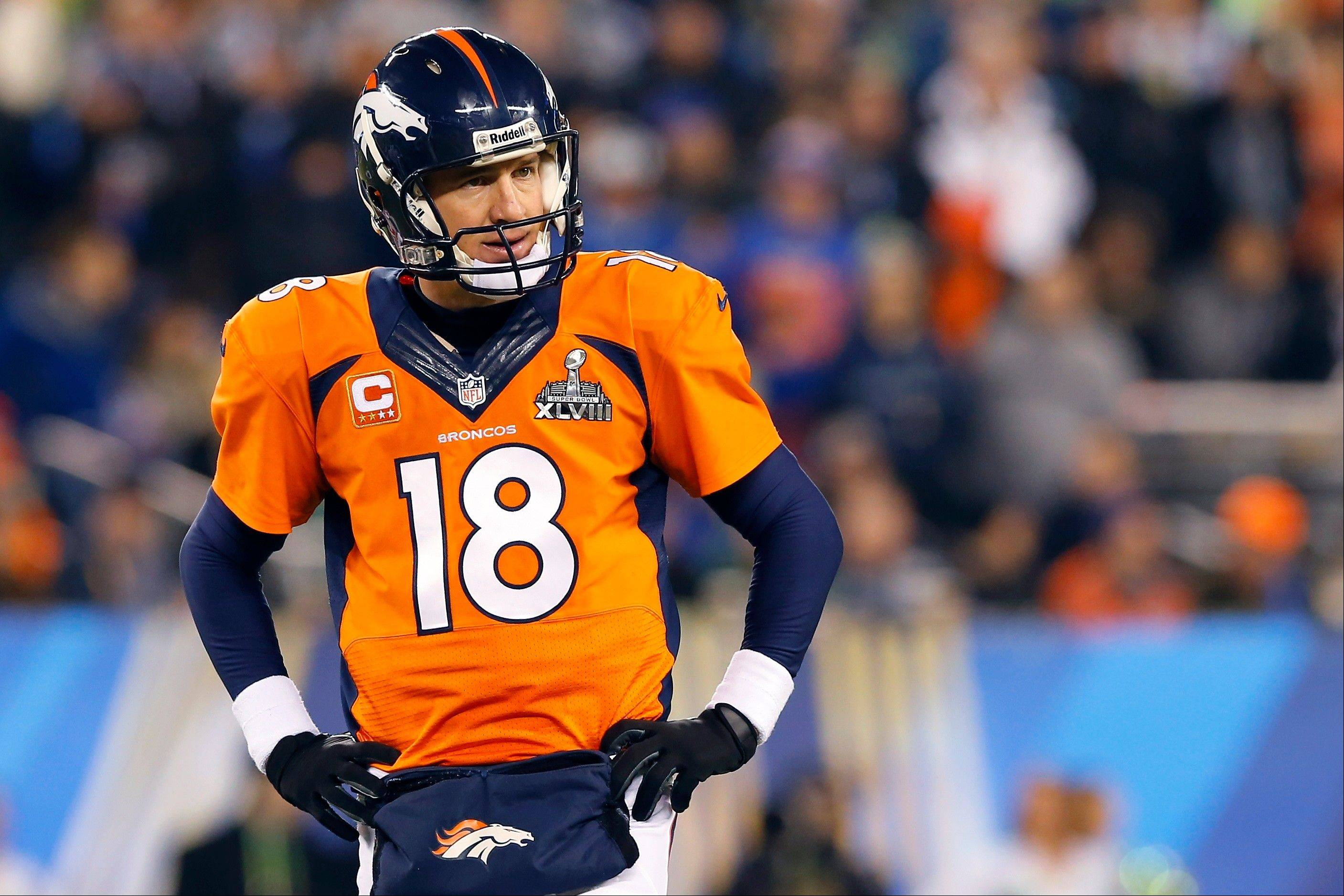 Denver Broncos' Peyton Manning pauses during the second half.