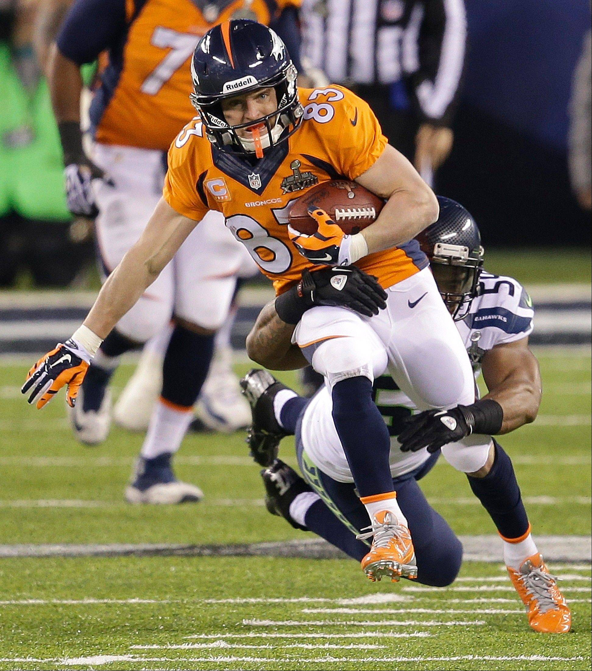 Denver Broncos wide receiver Wes Welker (83) is tackled by Seattle Seahawks middle linebacker Bobby Wagner (54) during the second half.