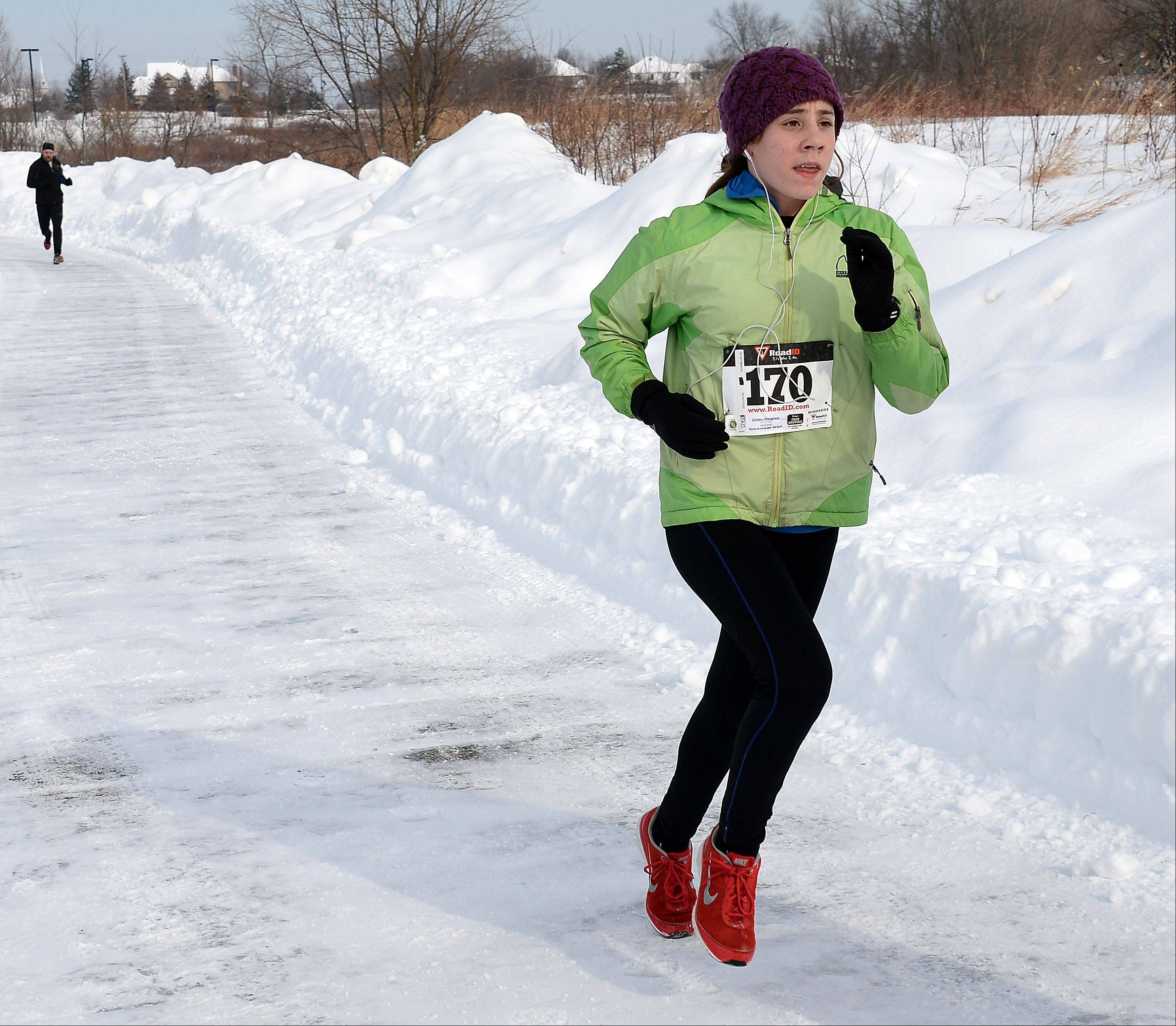 Mary Grace Golden, 14, of Batavia, finishes first in the woman's division of the Geneva Park District's 4th annual Super Shuffle 5K race on Sunday.