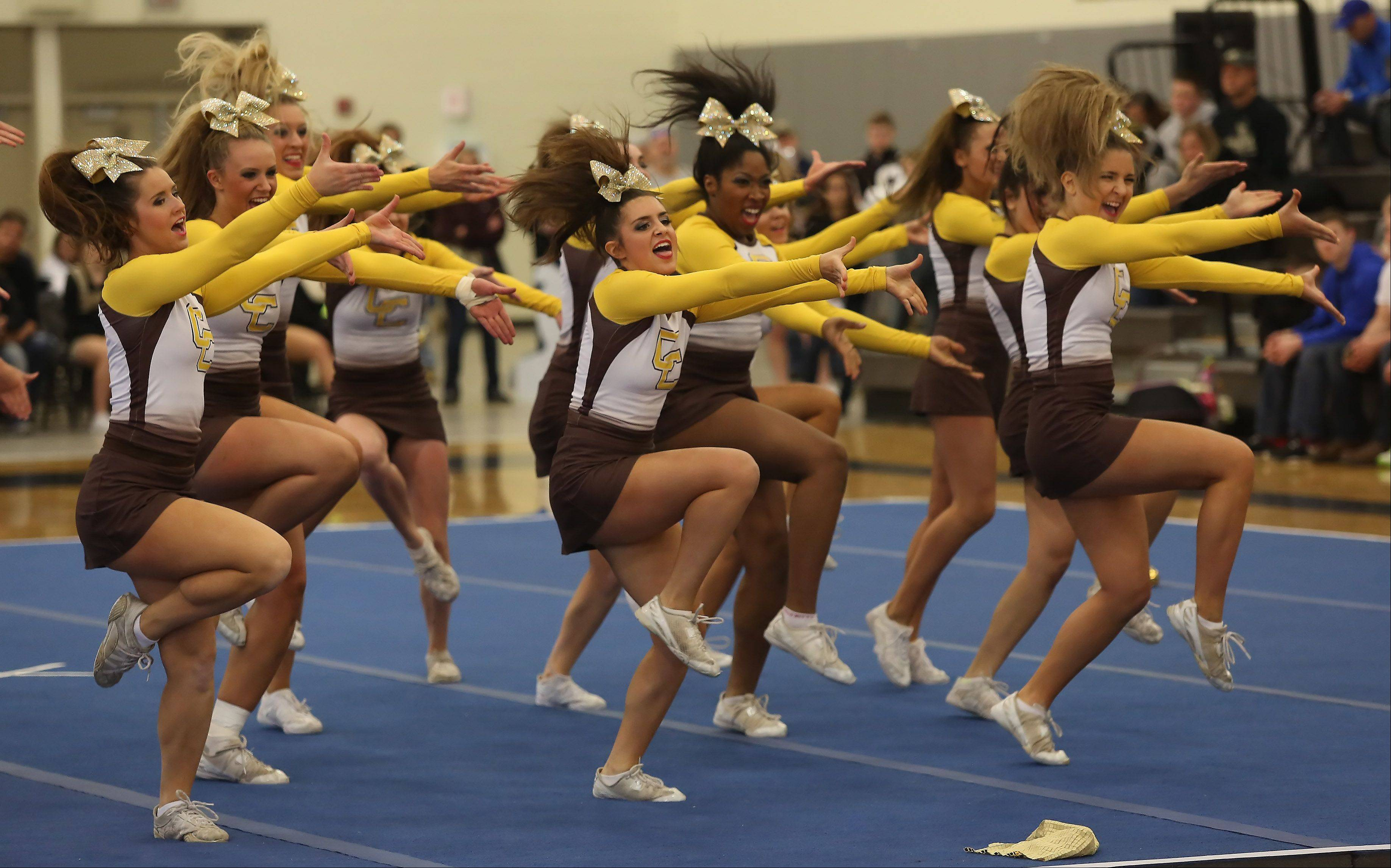 Carmel Catholic High School competes in the Large Team category Sunday during the IHSA Cheerleading Sectional at Grayslake North High School.