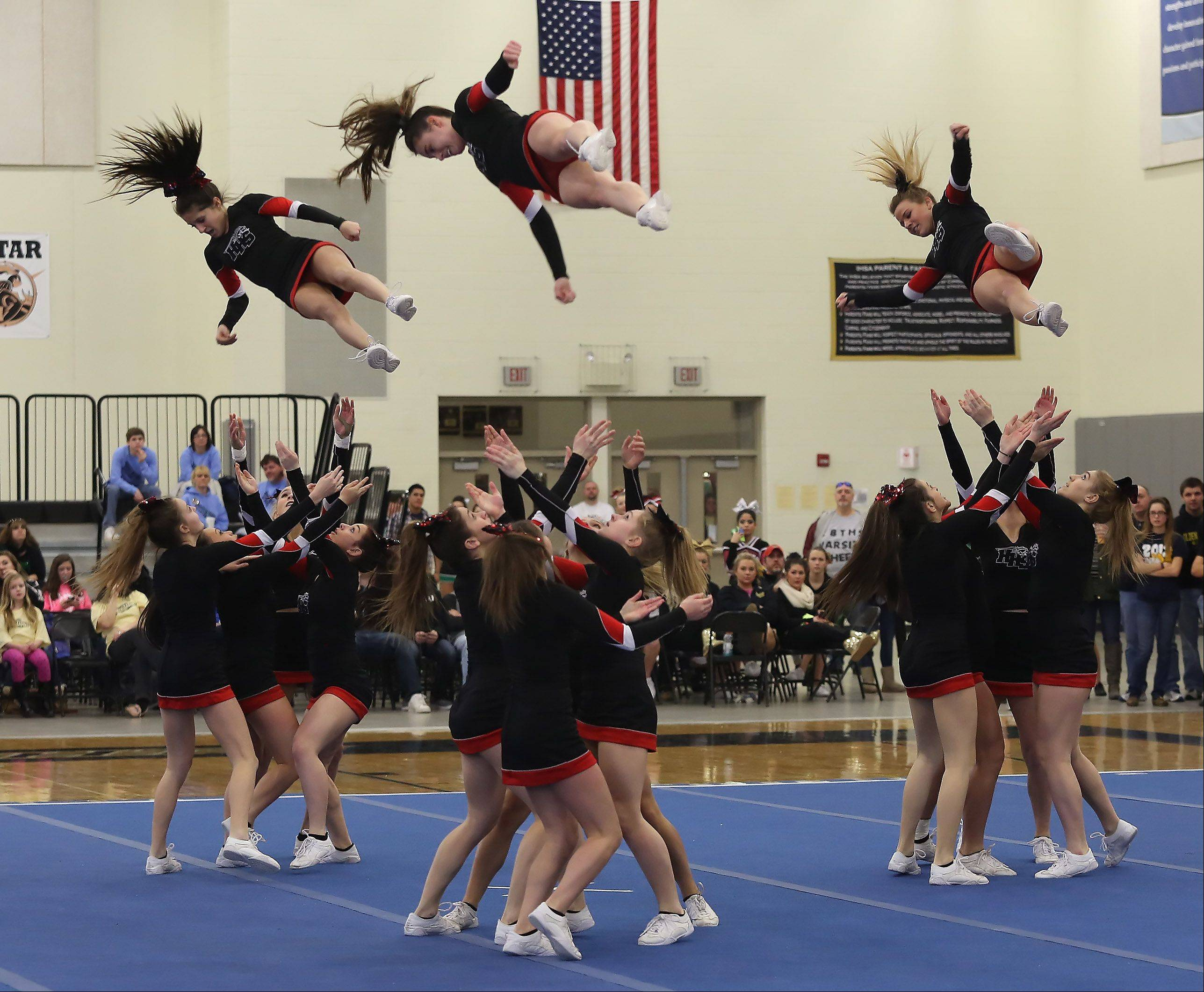 Huntley High School competes in the Large Team category Sunday during the IHSA Cheerleading Sectional at Grayslake North High School.