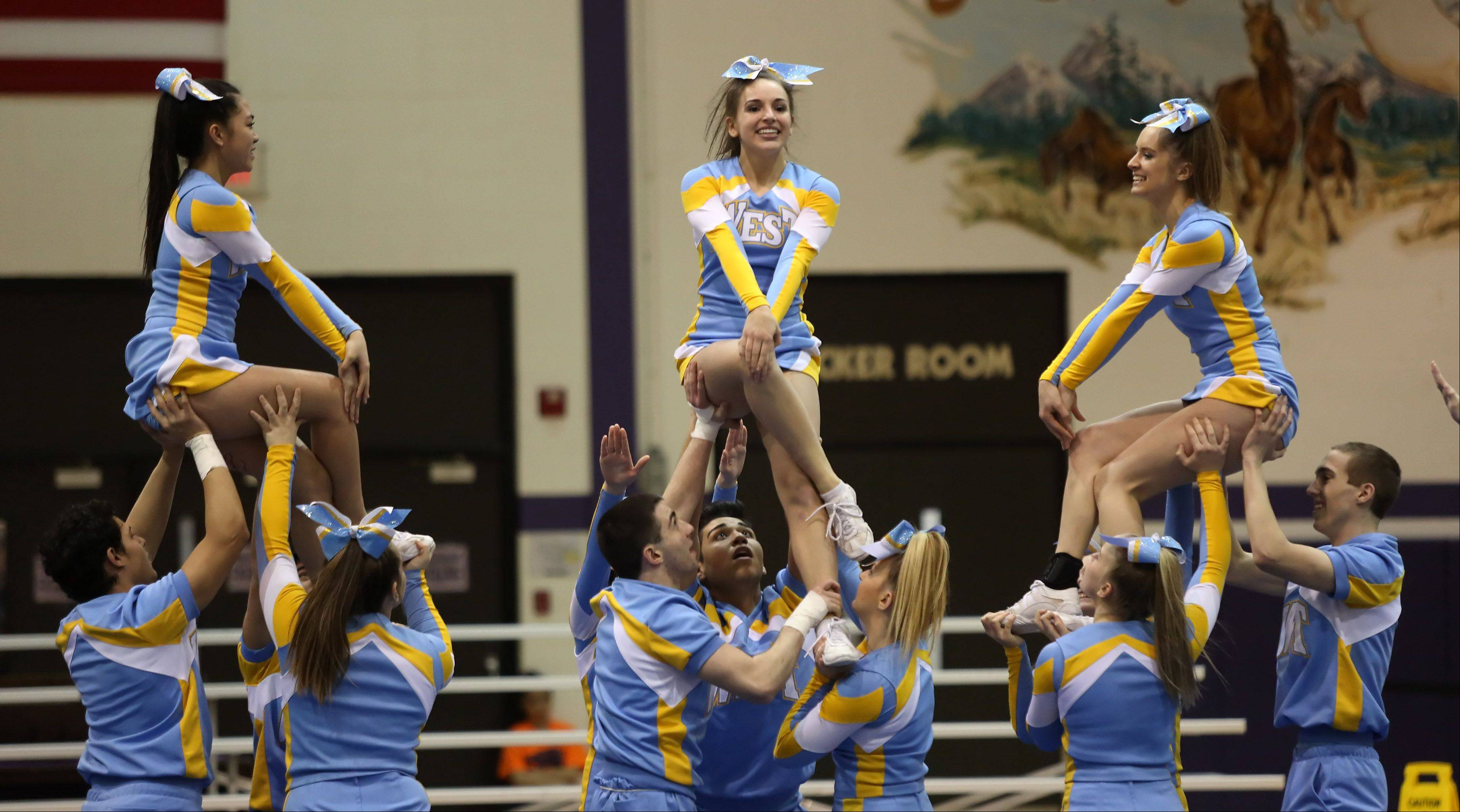 Maine West High School competes in the Coed Team category Sunday during the IHSA Cheerleading Sectional at Rolling Meadows High School.