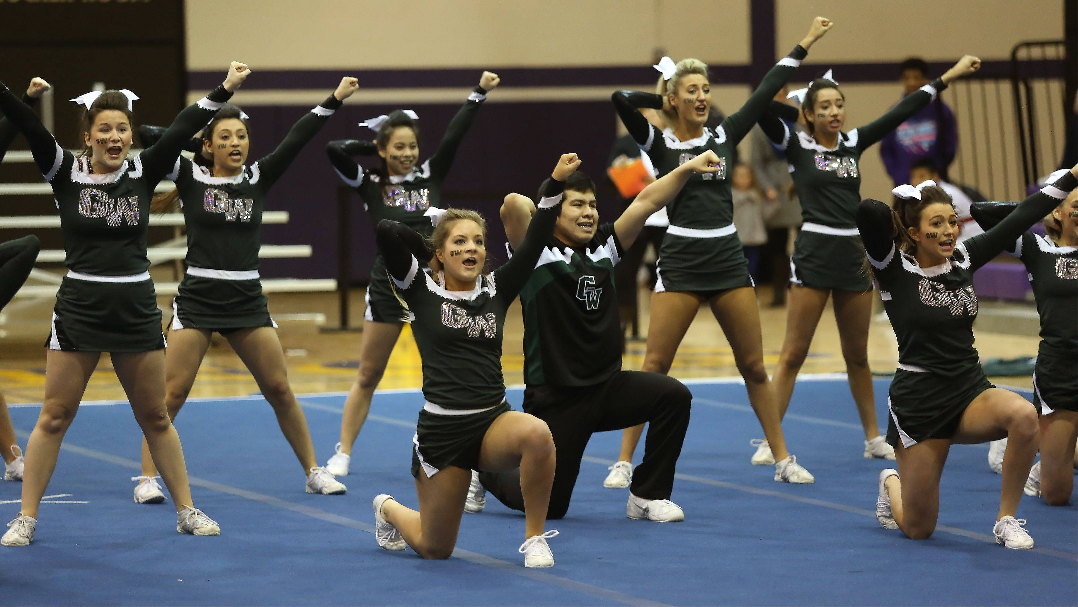 Glenbard West High School competes in the Coed Team category Sunday during the IHSA Cheerleading Sectional at Rolling Meadows High School.