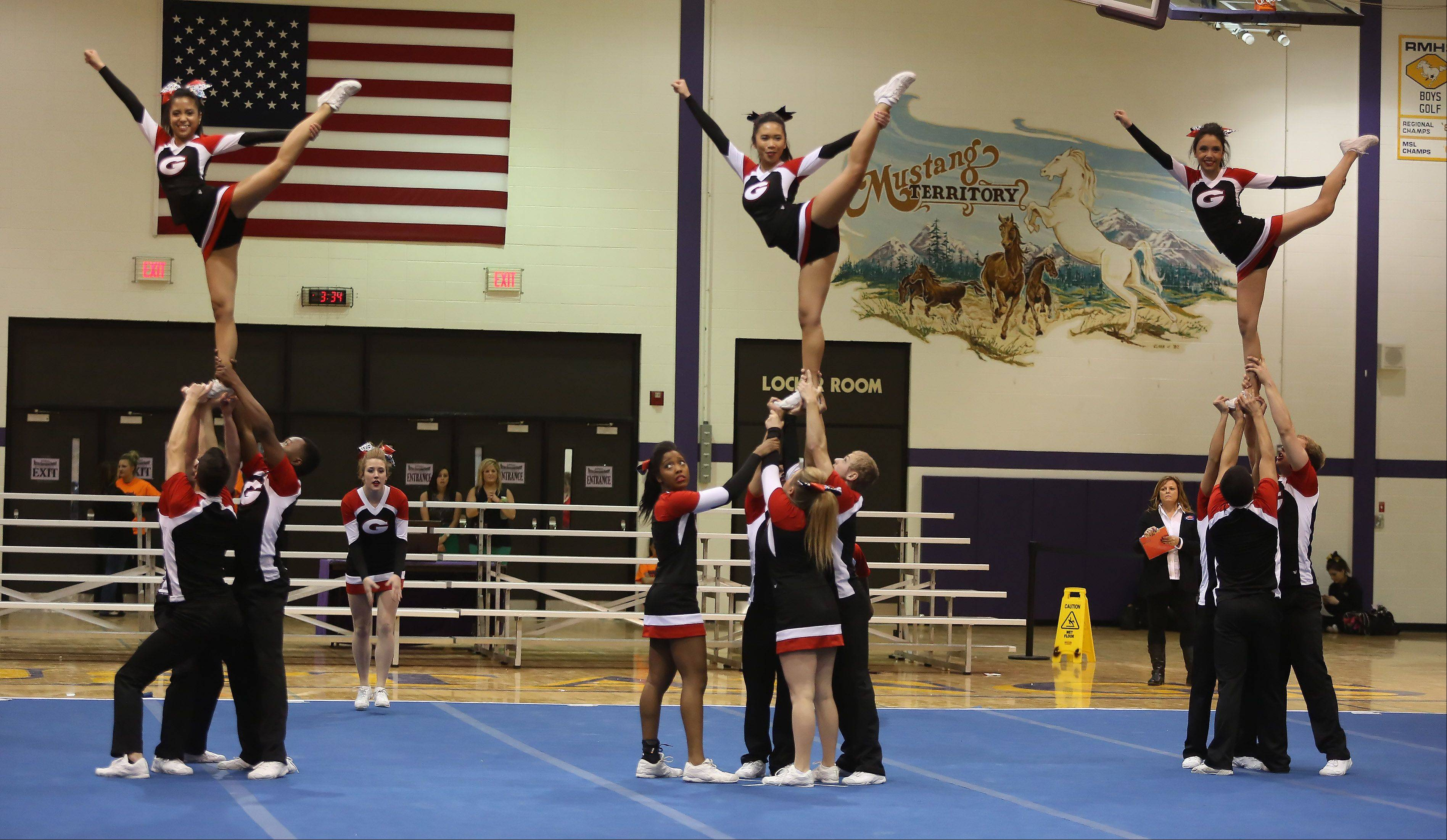 Glenbard East High School competes in the Coed Team category Saturday during the IHSA Cheerleading Sectional at Rolling Meadows High School.