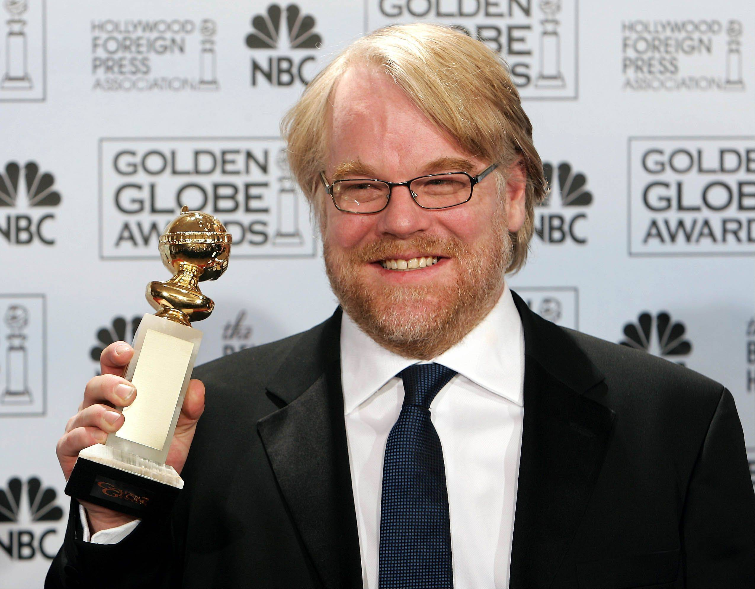 "Phillip Seymour Hoffman poses with the award he won for best actor in a drama for his work in ""Capote,"" at the 63rd Annual Golden Globe Awards in a Monday, Jan. 16, 2006 photo, in Beverly Hills, Calif."