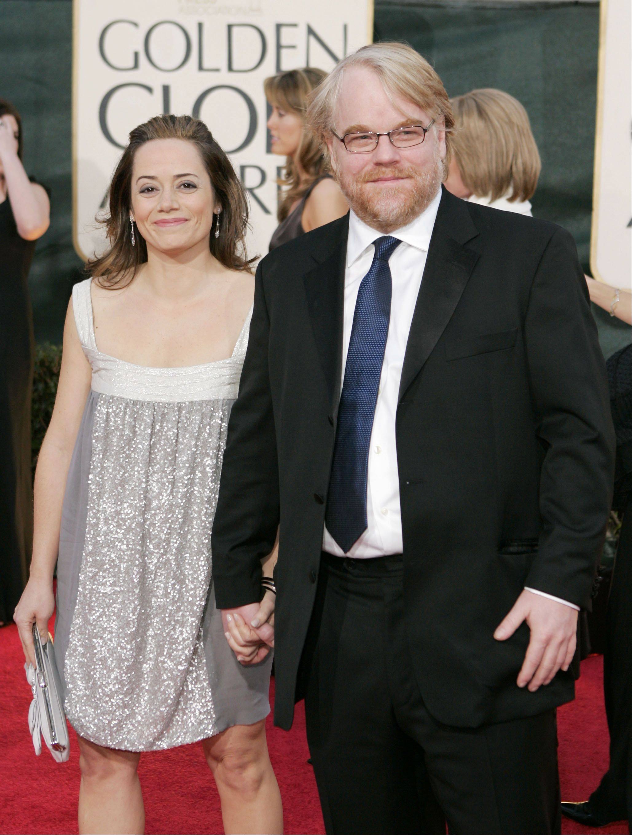 Philip Seymour Hoffman arrives with wife Mimi O'Donnell for the 63rd Annual Golden Globe Awards on Monday, Jan. 16, 2006, in Beverly Hills, Calif.