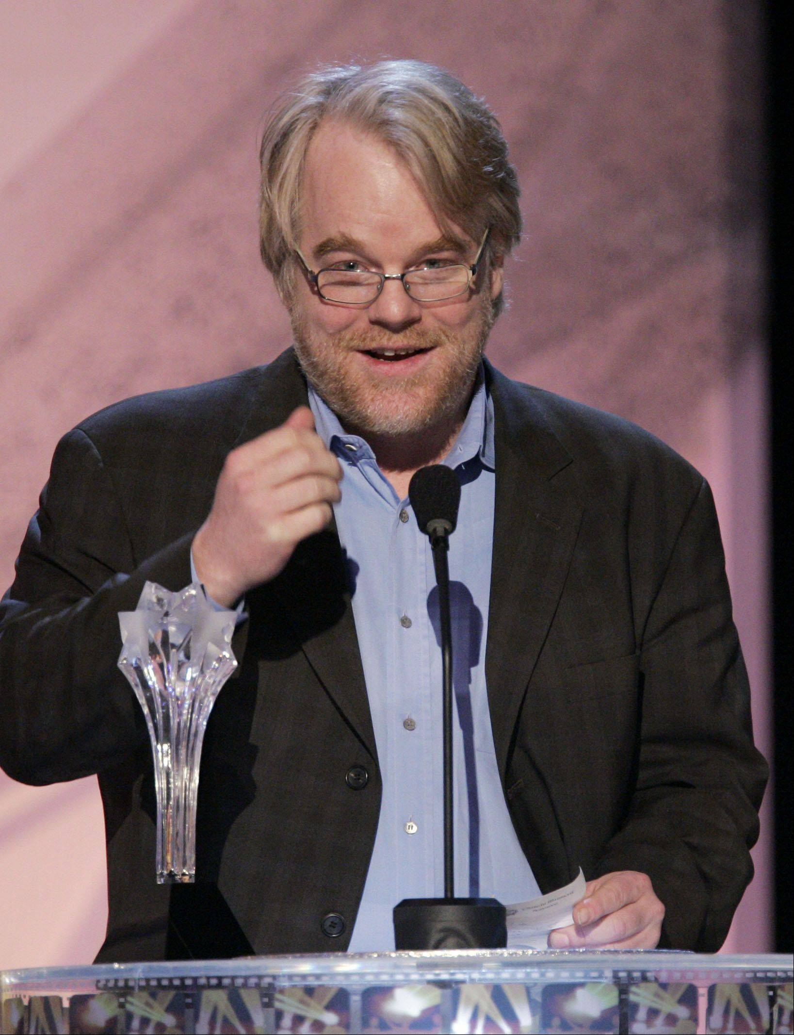 "Philip Seymour Hoffman accepts the award for best actor, for his work in the film ""Capote,"" at the 11th Annual Critics' Choice Awards in Santa Monica, Calif., Monday, Jan. 9, 2006."