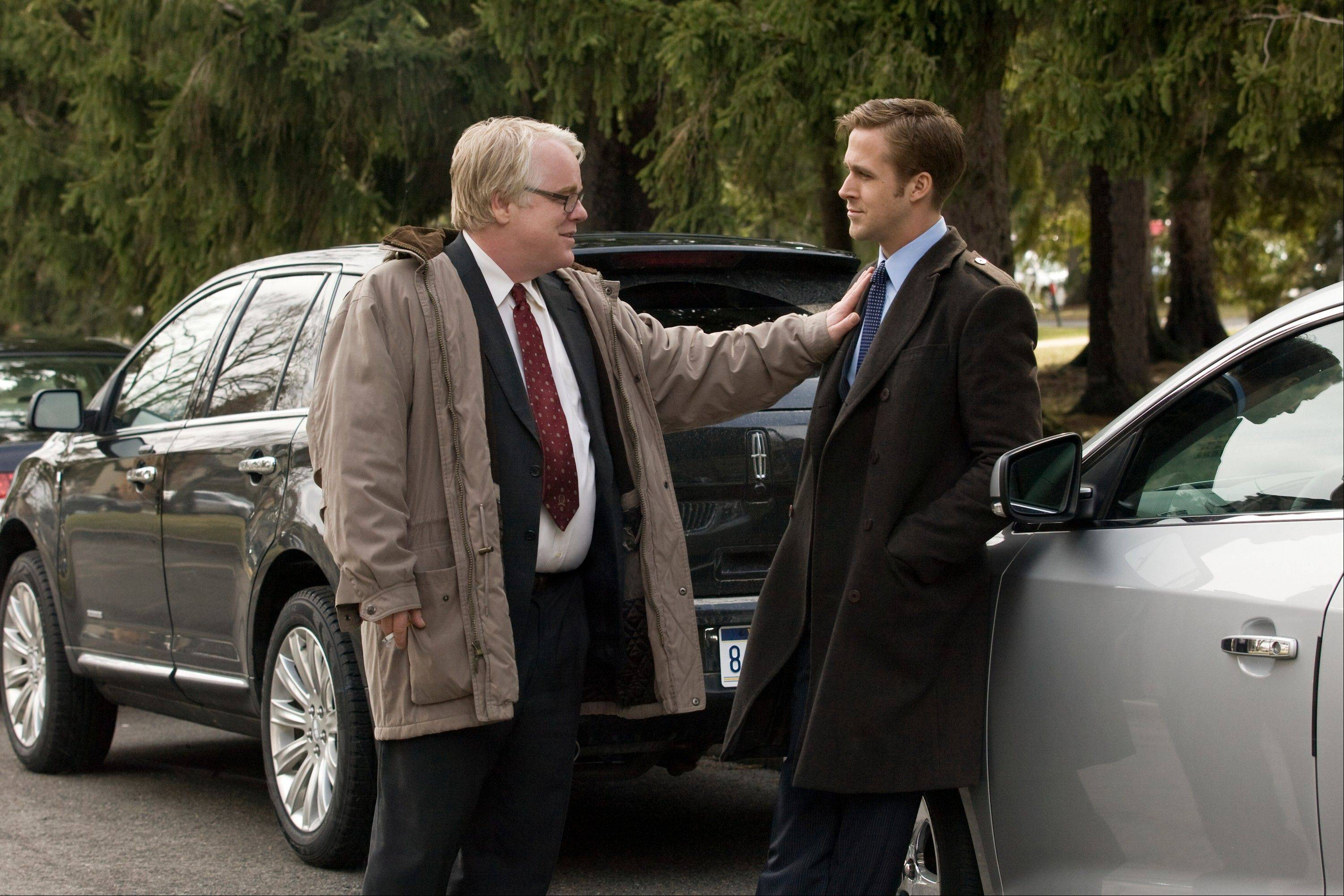 "Philip Seymour Hoffman, left, and Ryan Gosling starred in ""The Ides of March,"" a 2011 political drama directed by George Clooney."