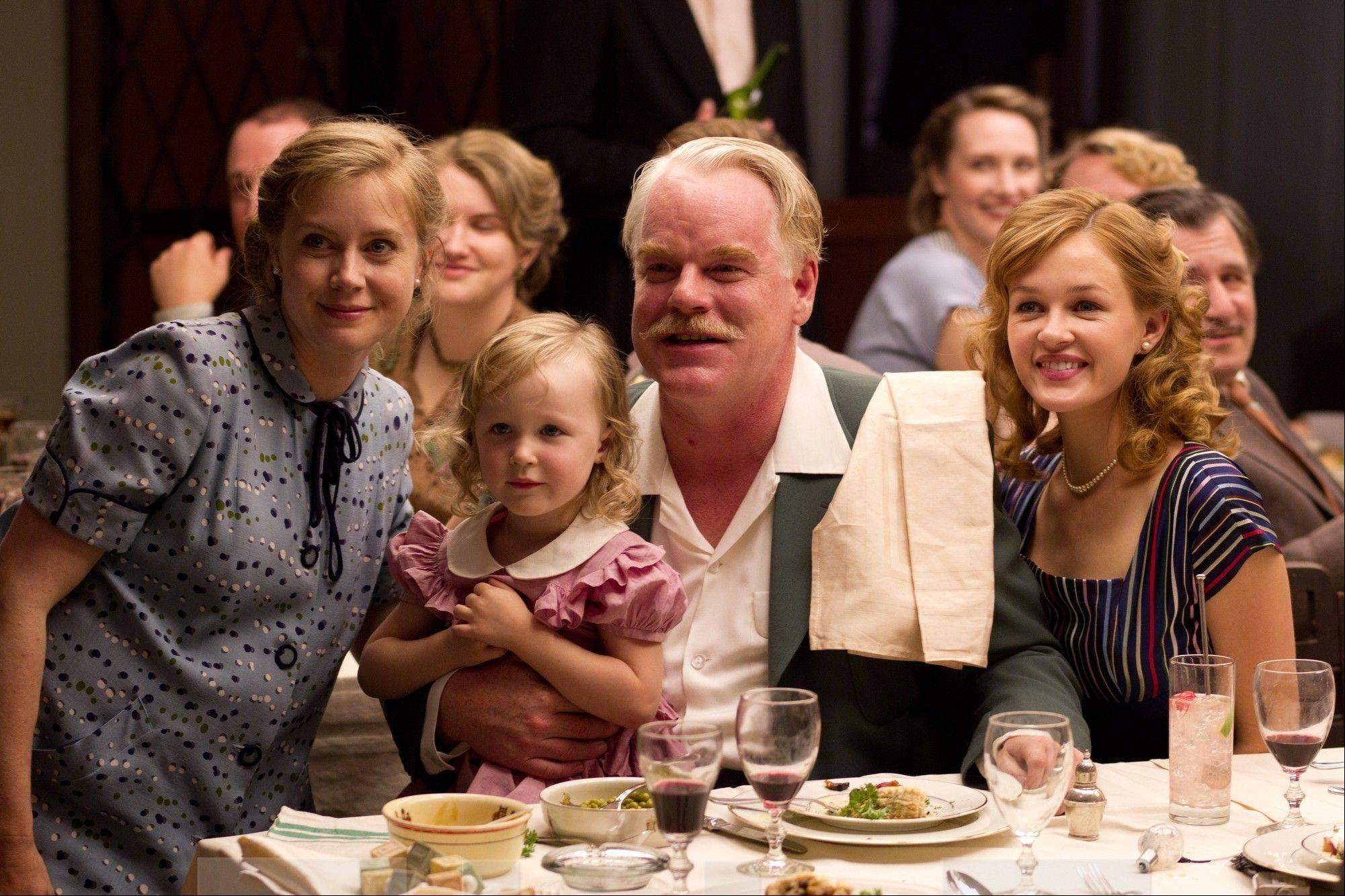 "Philip Seymour Hoffman, center, and co-star Amy Adams, left, in a scene from Paul Thomas Anderson's ""The Master."""