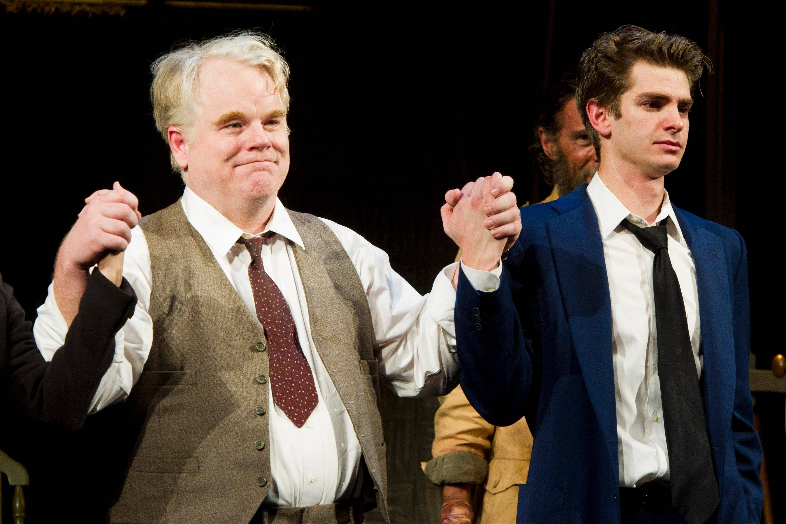 "In this March 15, 2012 file photo, actors Philip Seymour Hoffman, left, and Andrew Garfield appear at the curtain call for the opening night performance of the Broadway revival of Arthur Miller's ""Death of A Salesman"" in New York."