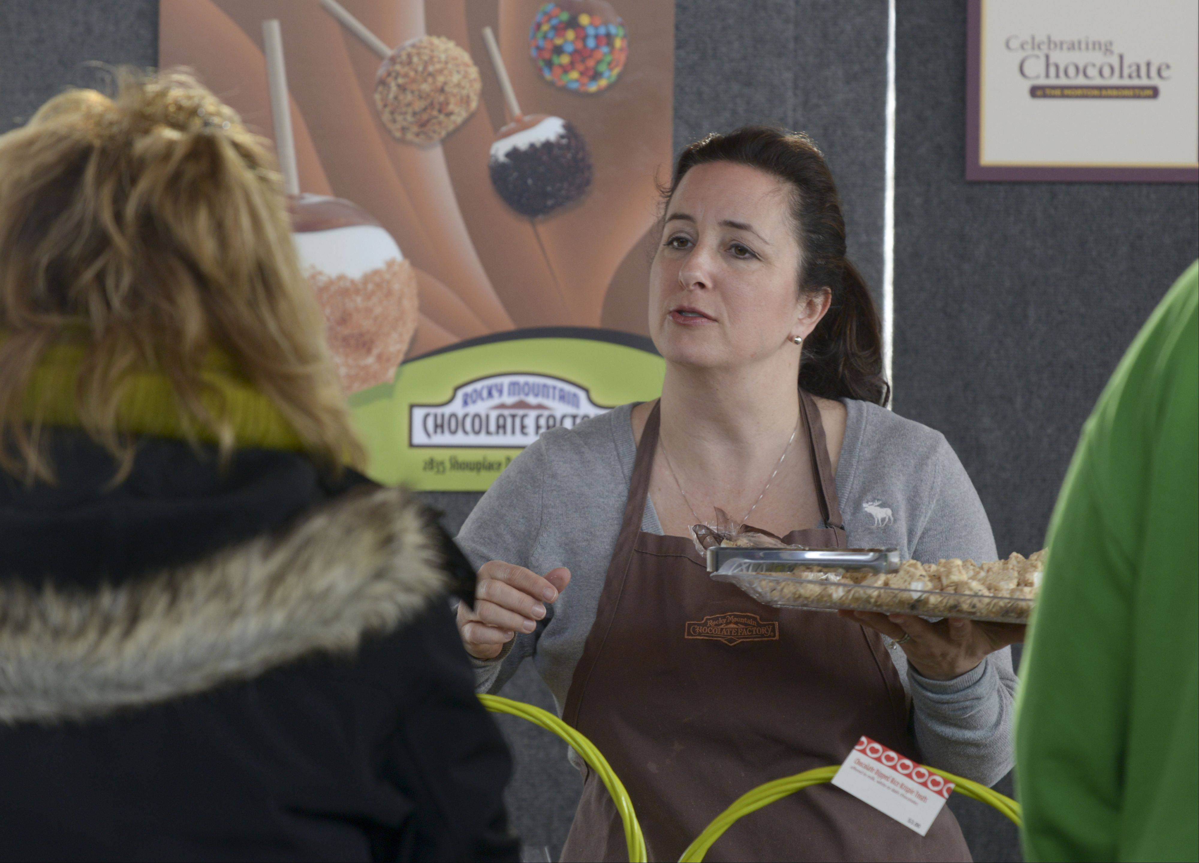 Heather Mansholt, owner of Rocky Mountain Chocolate Factory in Naperville, hands out samples Sunday during the Morton Arboretum's Chocolate Expo and Market. The event featured nearly 20 vendors offering different chocolate concoctions.