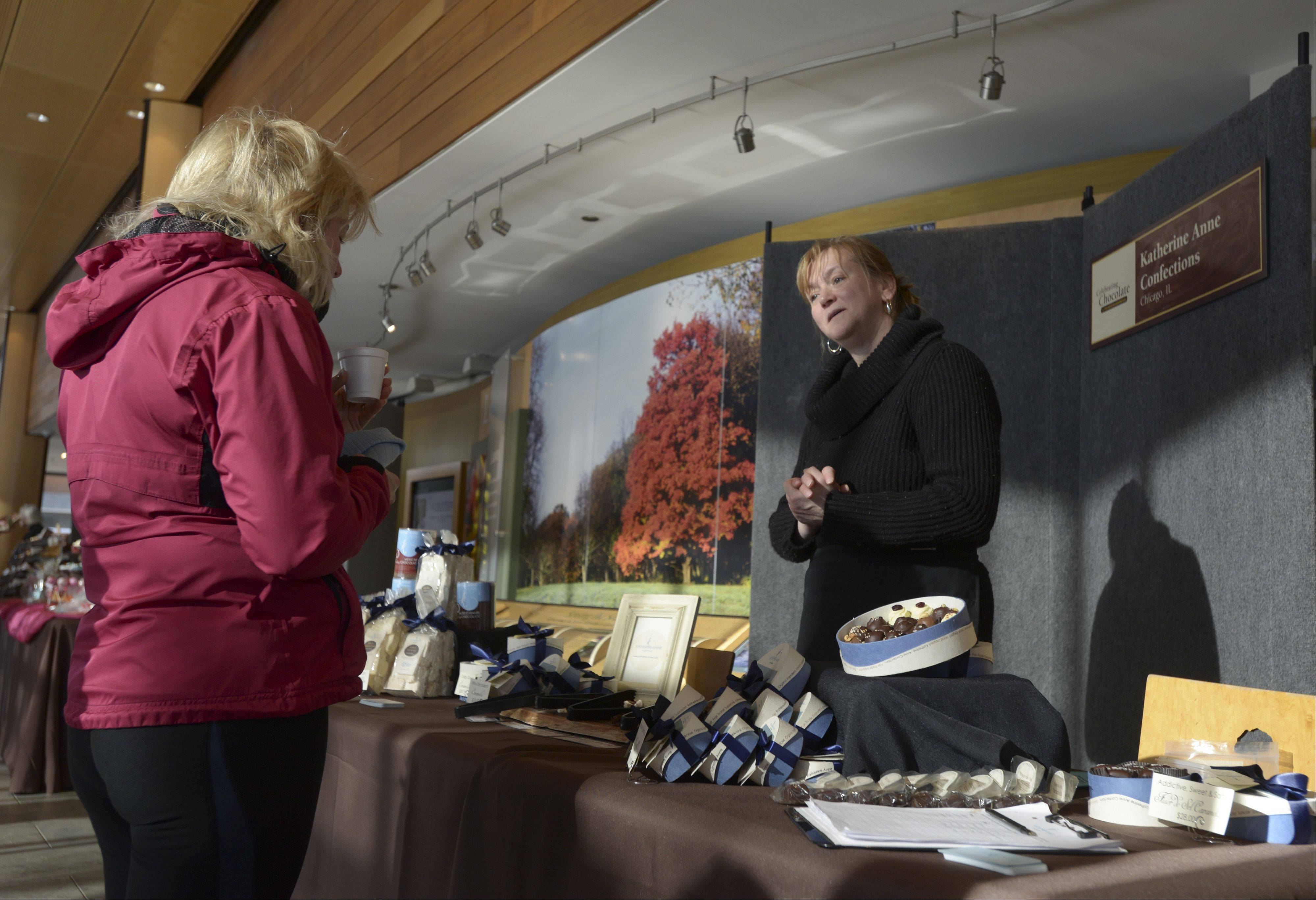 Patty Formosa of Katherine Anne Confections in Chicago hands out samples Sunday during the Morton Arboretum's Chocolate Expo and Market. The event featured nearly 20 vendors offering different chocolate concoctions.