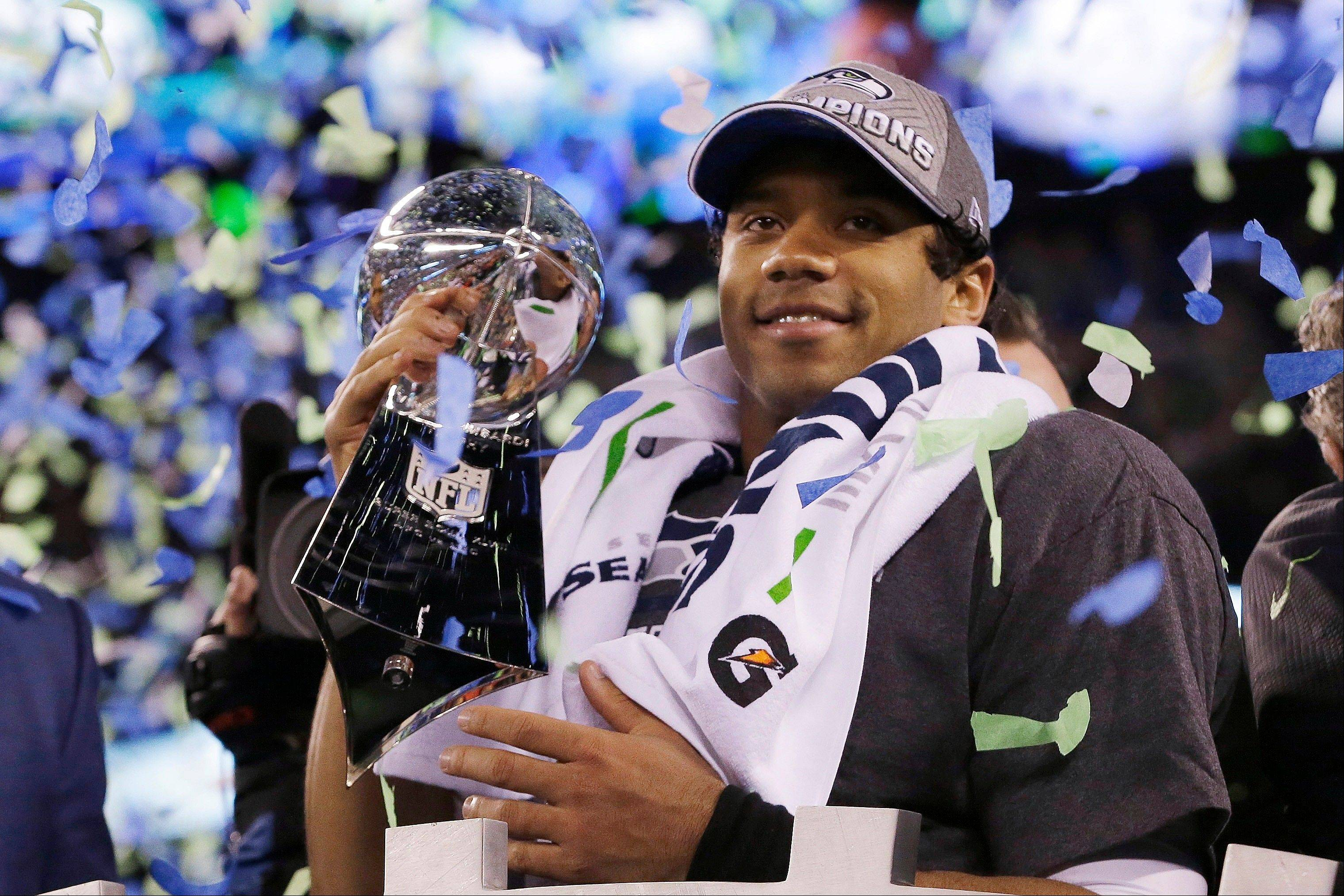 Seattle Seahawks quarterback Russell Wilson holds the Lombardi Trophy after the NFL Super Bowl XLVIII football game Sunday, Feb. 2, 2014, in East Rutherford, N.J. The Seahawks won 43-8.