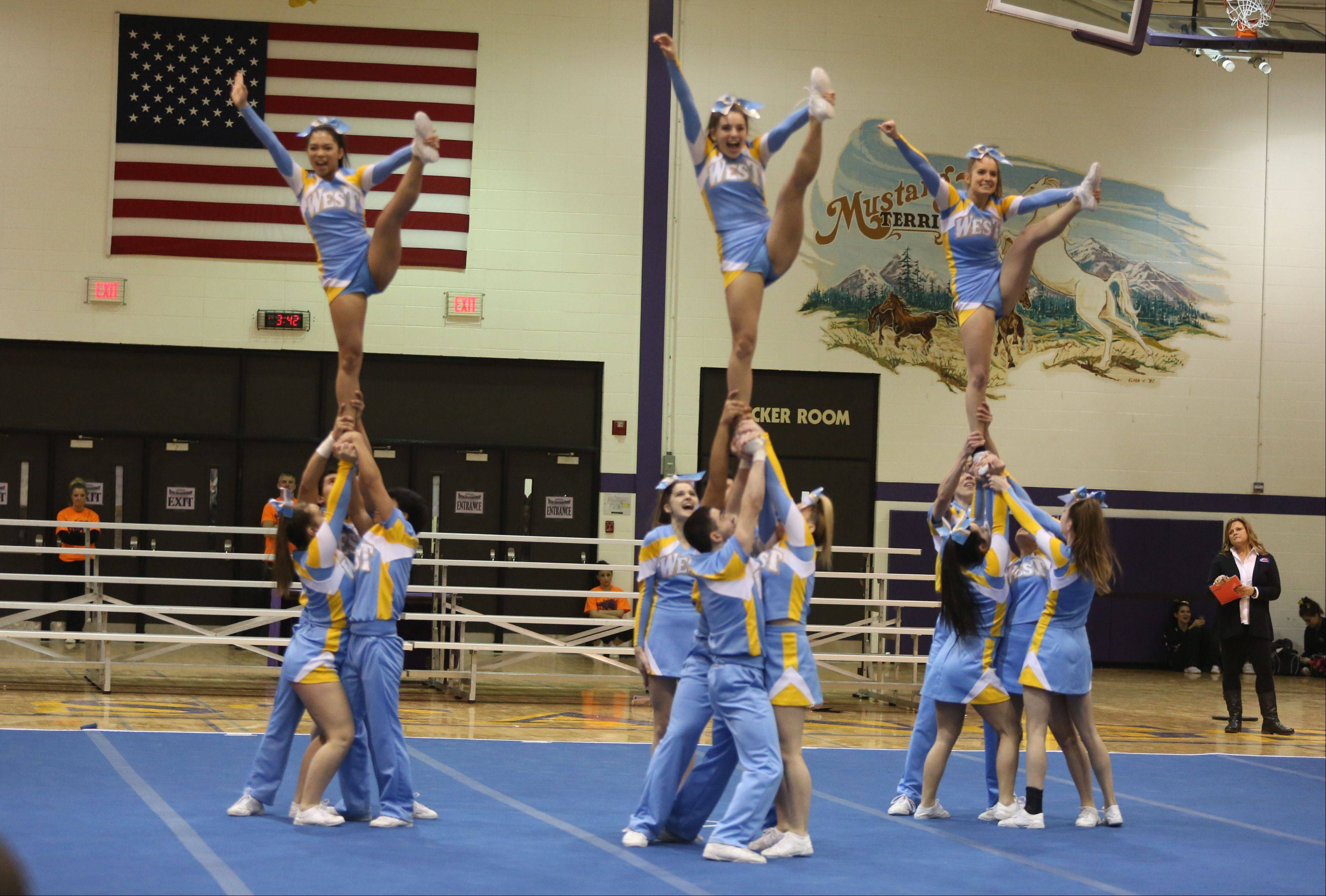 Maine West High School competes in the Coed Team category during the IHSA Cheerleading Sectional Sunday hosted by Rolling Meadows High School.