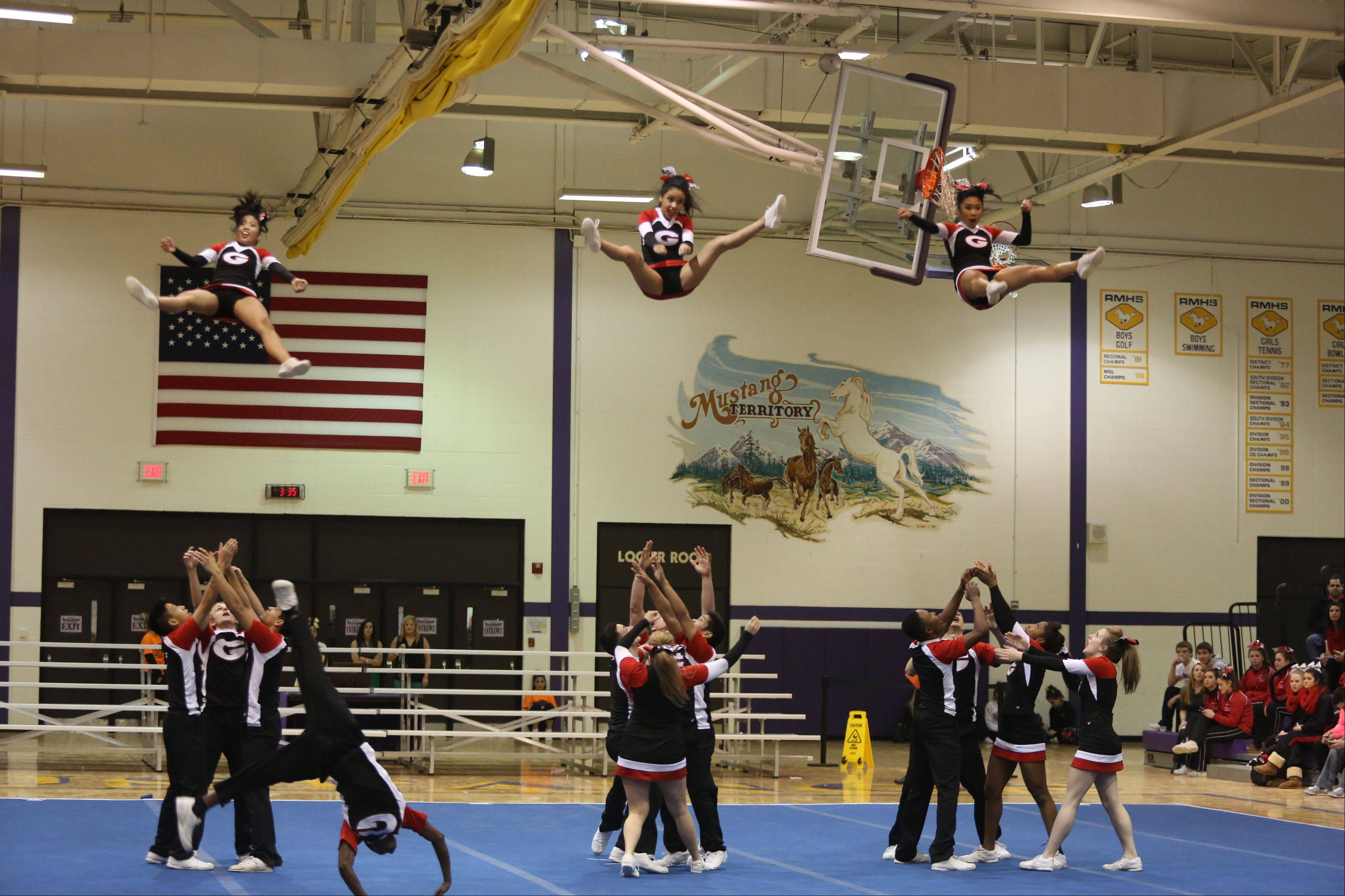Glenbard East High School competes in the Coed Team category during the IHSA Cheerleading Sectional Sunday hosted by Rolling Meadows High School.