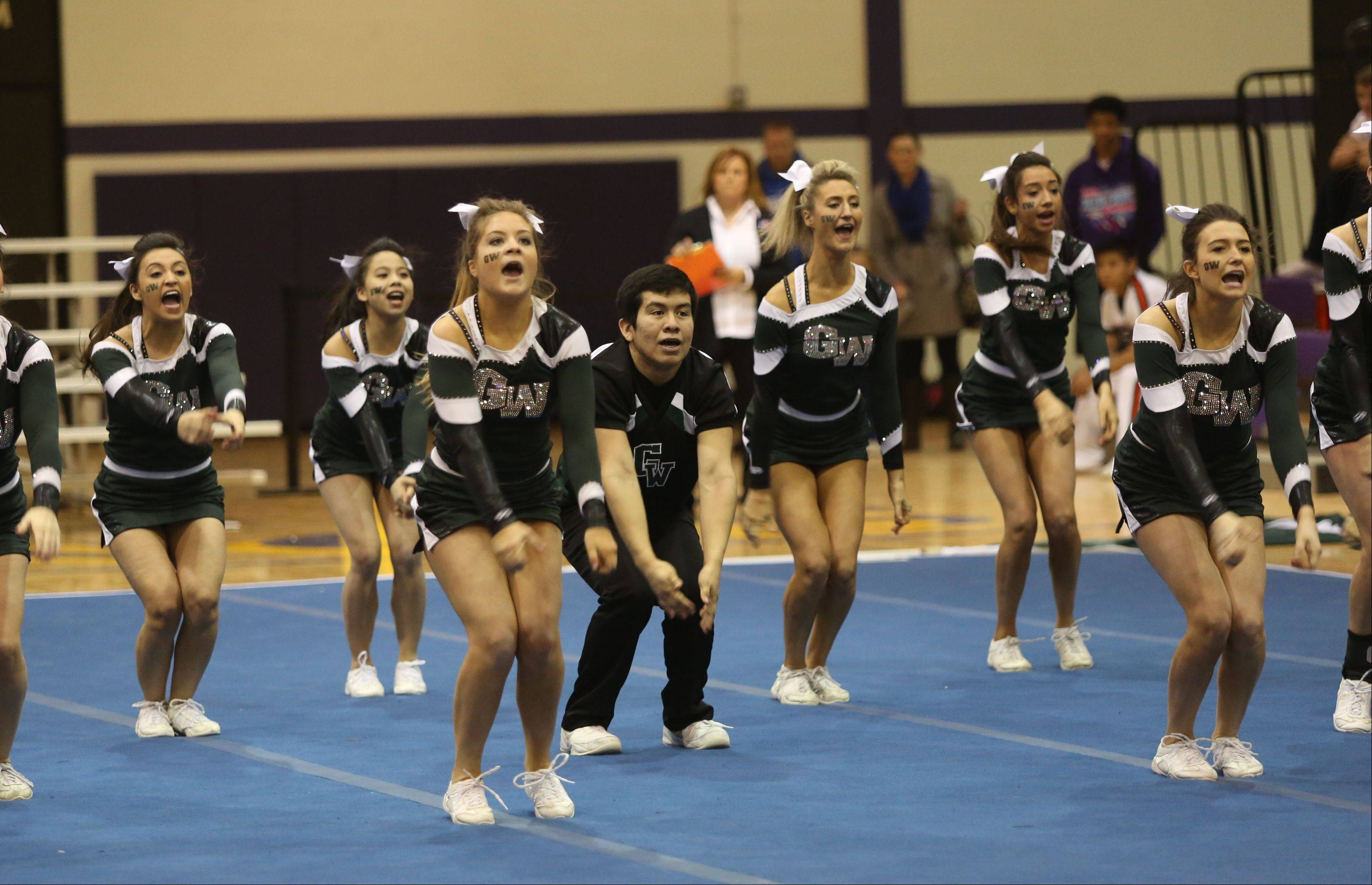 Glenbard West High School competes in the Coed Team category during the IHSA Cheerleading Sectional Sunday hosted by Rolling Meadows High School.