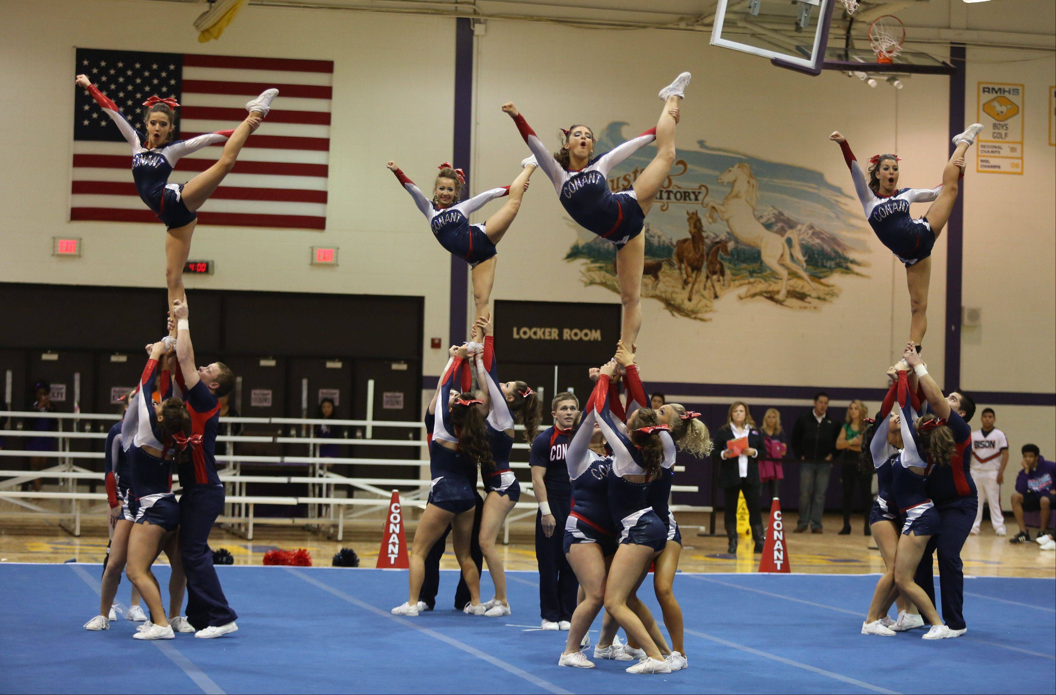 Conant High School competes in the Coed Team category during the IHSA Cheerleading Sectional Sunday hosted by Rolling Meadows High School.