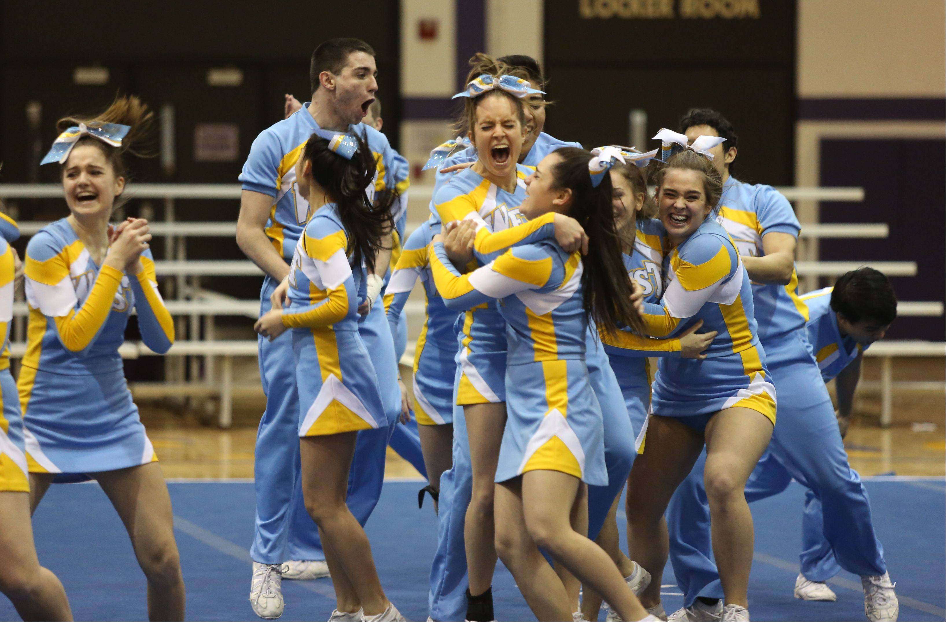 Maine West High School celebrate after competing in the Coed Team category during the IHSA Cheerleading Sectional Sunday hosted by Rolling Meadows High School.