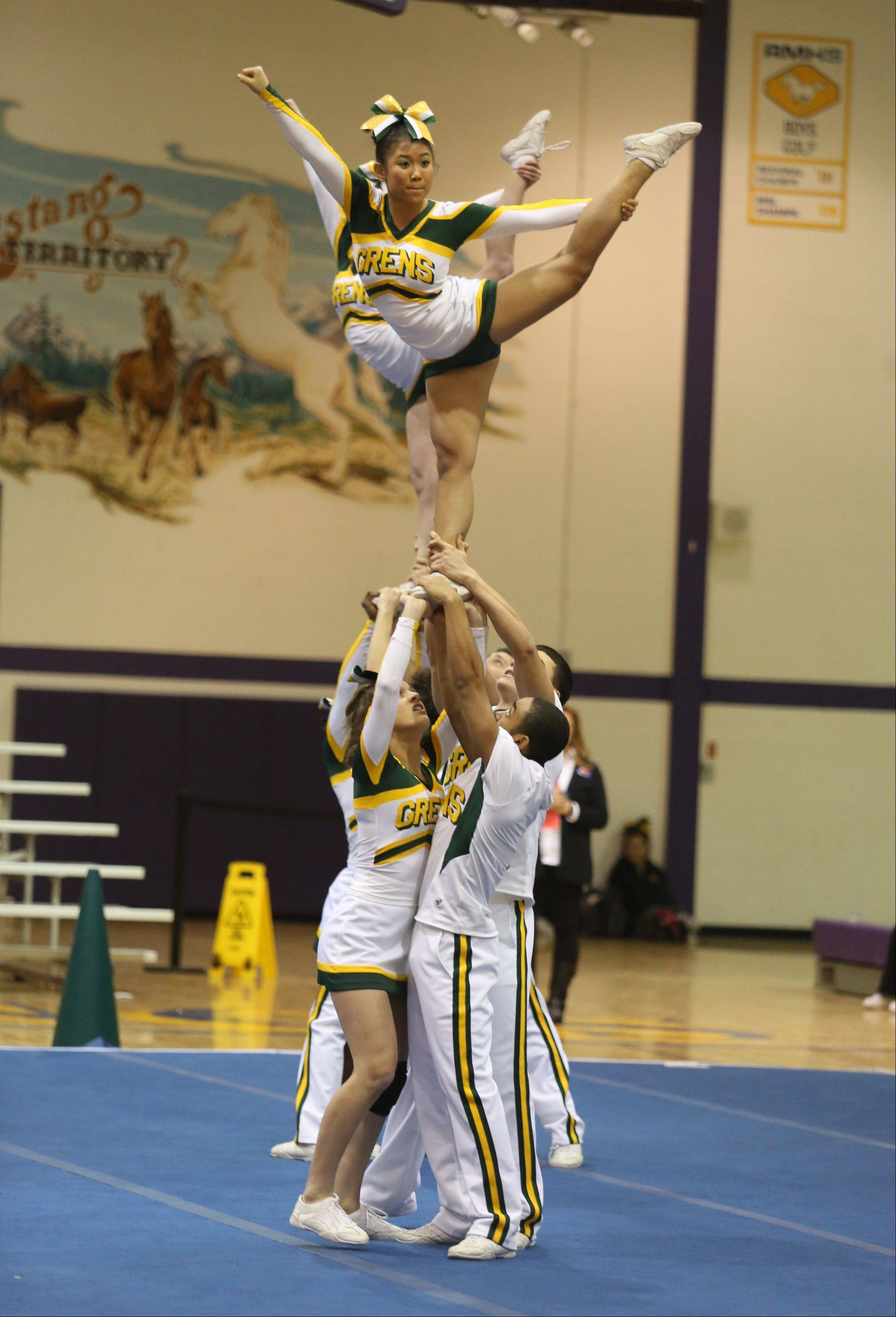 Elk Grove High School competes in the Coed Team category during the IHSA Cheerleading Sectional Sunday hosted by Rolling Meadows High School.