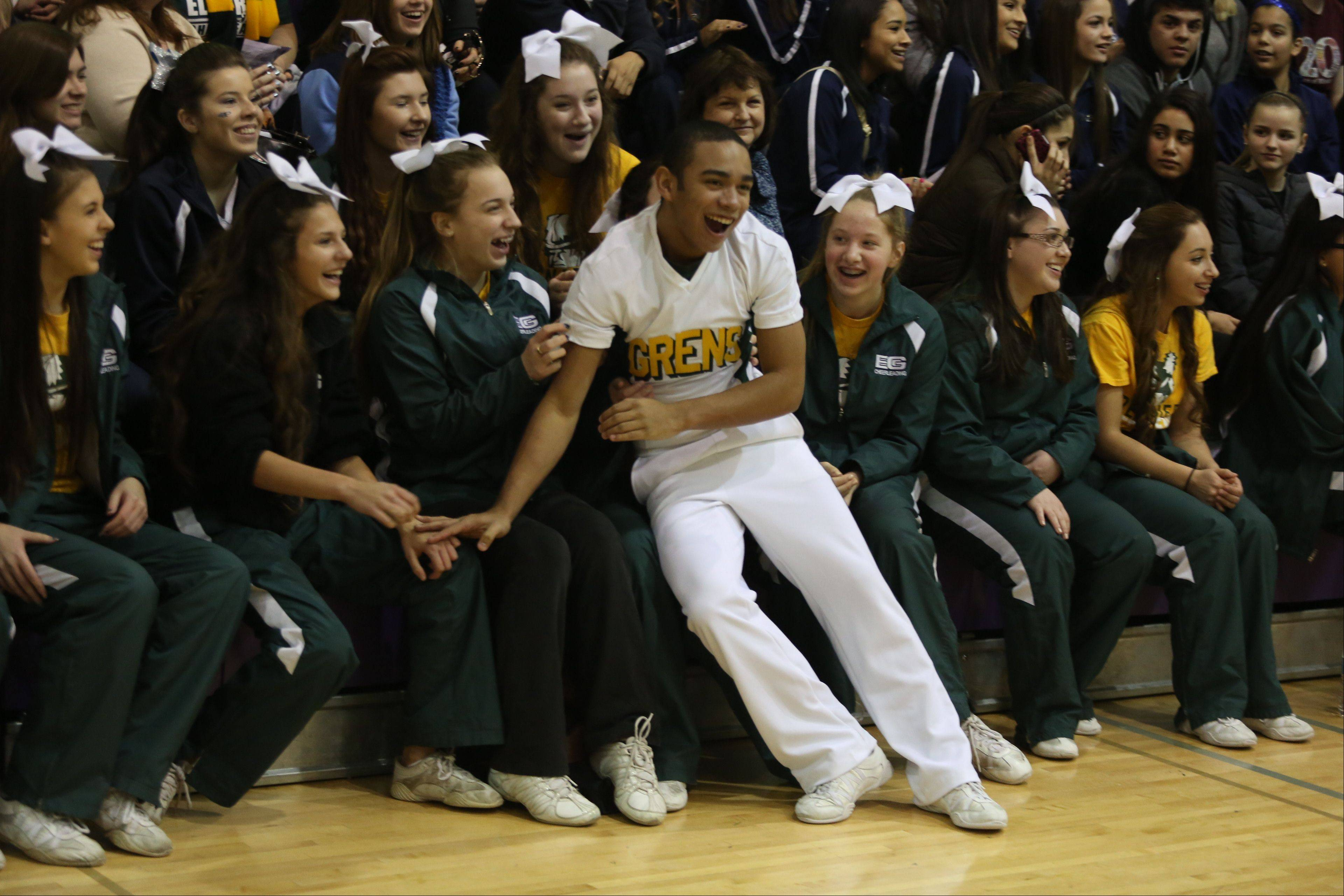 Fans cheer Elk Grove High School team after they compete in the Coed Team category during the IHSA Cheerleading Sectional Sunday hosted by Rolling Meadows High School.