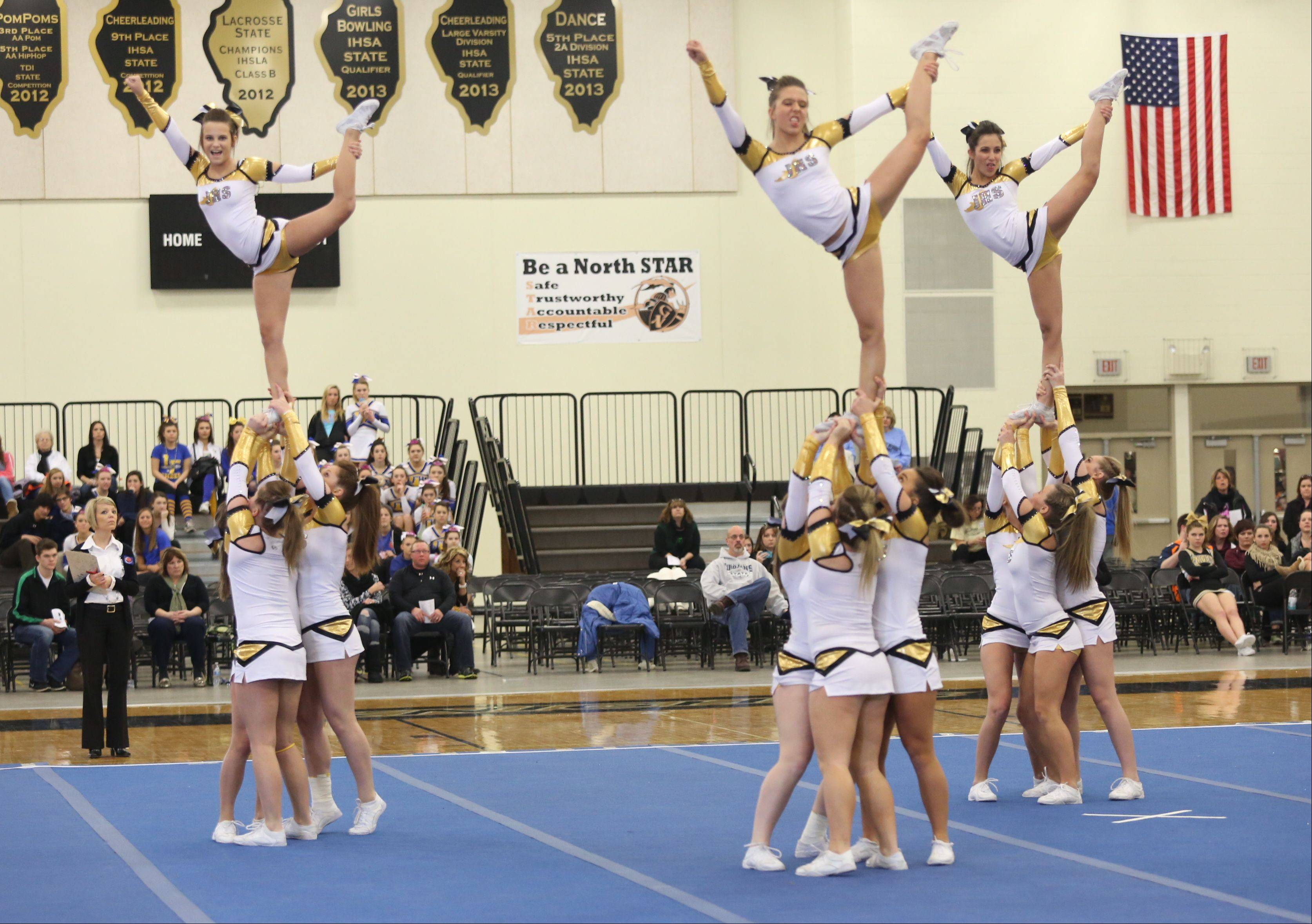 Jacobs High School competes in the Large Team category during the IHSA Cheerleading Sectional Sunday hosted by Grayslake North High School.