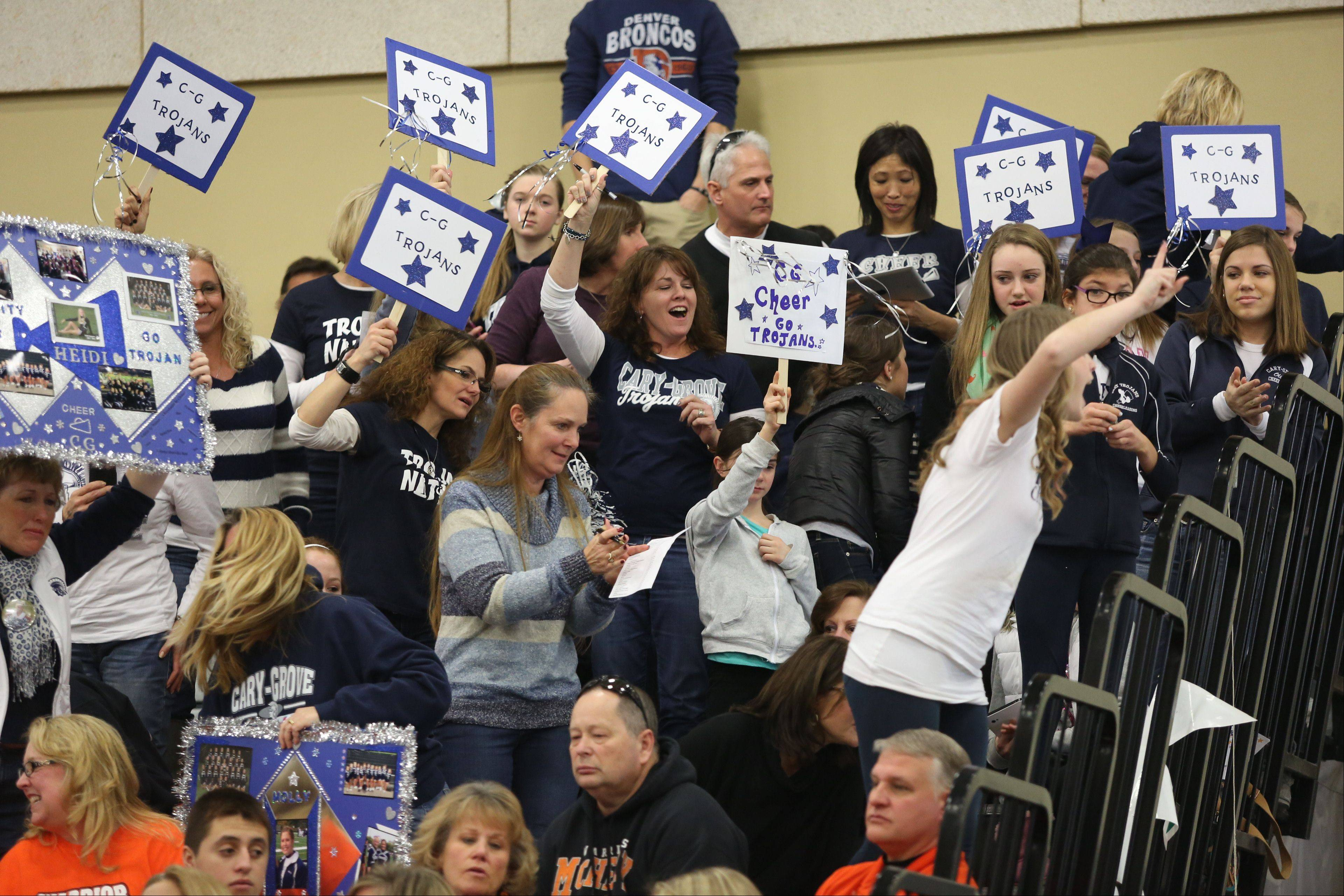 Cary-Grove High School fans cheer on the team during the IHSA Cheerleading Sectional Sunday hosted by Grayslake North High School.