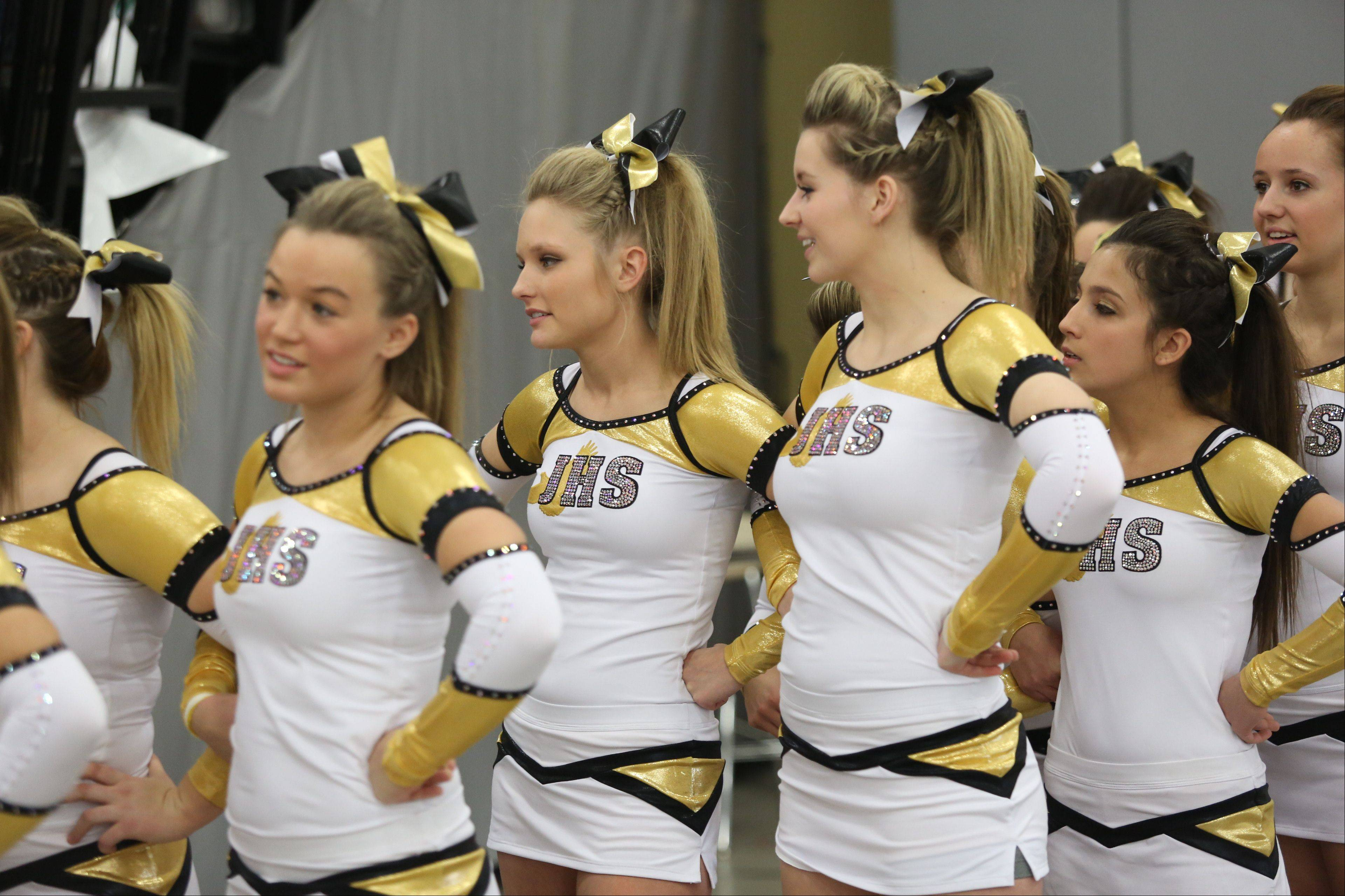 Jacobs High School cheerleaders wait to compete in the Large Team category during the IHSA Cheerleading Sectional Sunday hosted by Grayslake North High School.