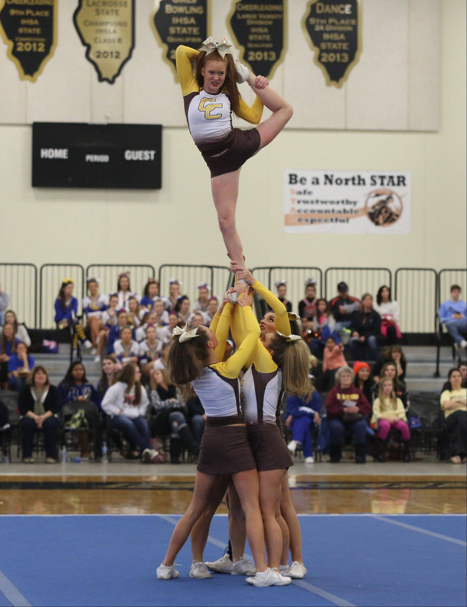 Carmel Catholic High School competes in the Large Team category during the IHSA Cheerleading Sectional Sunday hosted by Grayslake North High School.