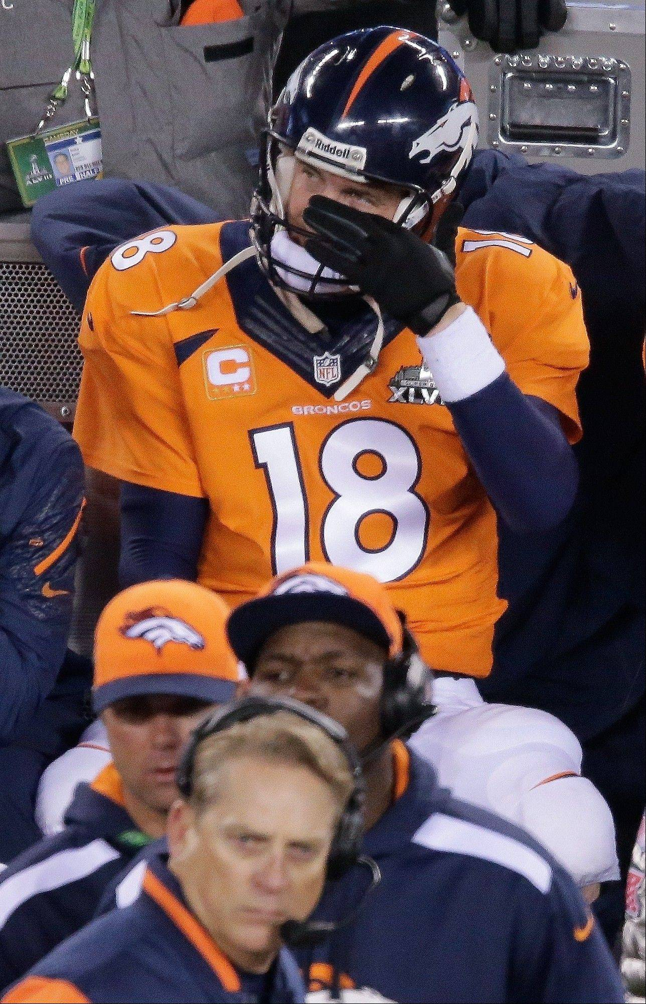 Denver Broncos' Peyton Manning watches play against the Seattle Seahawks during the second half of the NFL Super Bowl XLVIII football game Sunday, Feb. 2, 2014, in East Rutherford, N.J.