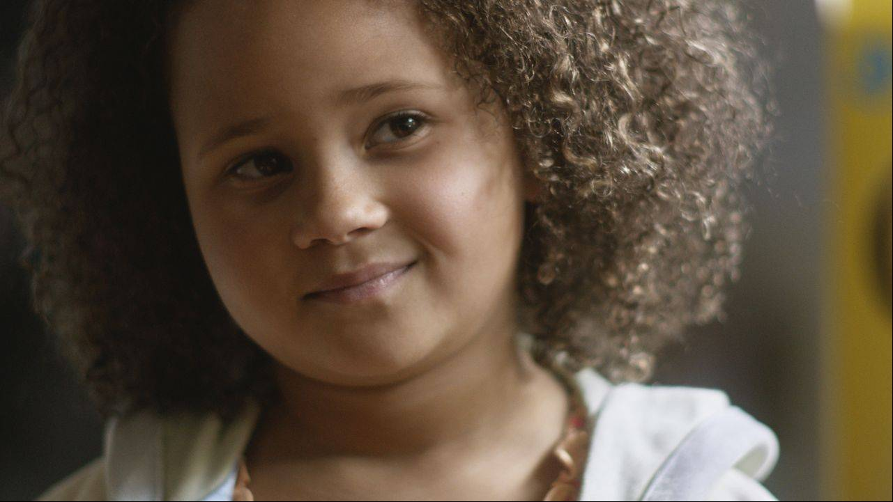 "This undated frame grab provided by General Mill's shows the company's 2014 Super Bowl for Cheerios entitled ""Gracie."" Cheerios brings back its famous interracial family in a spot that shows a father using Cheerios to tell his daughter she's going to have a brother. The ad airs during the first unscheduled timeout of the game."