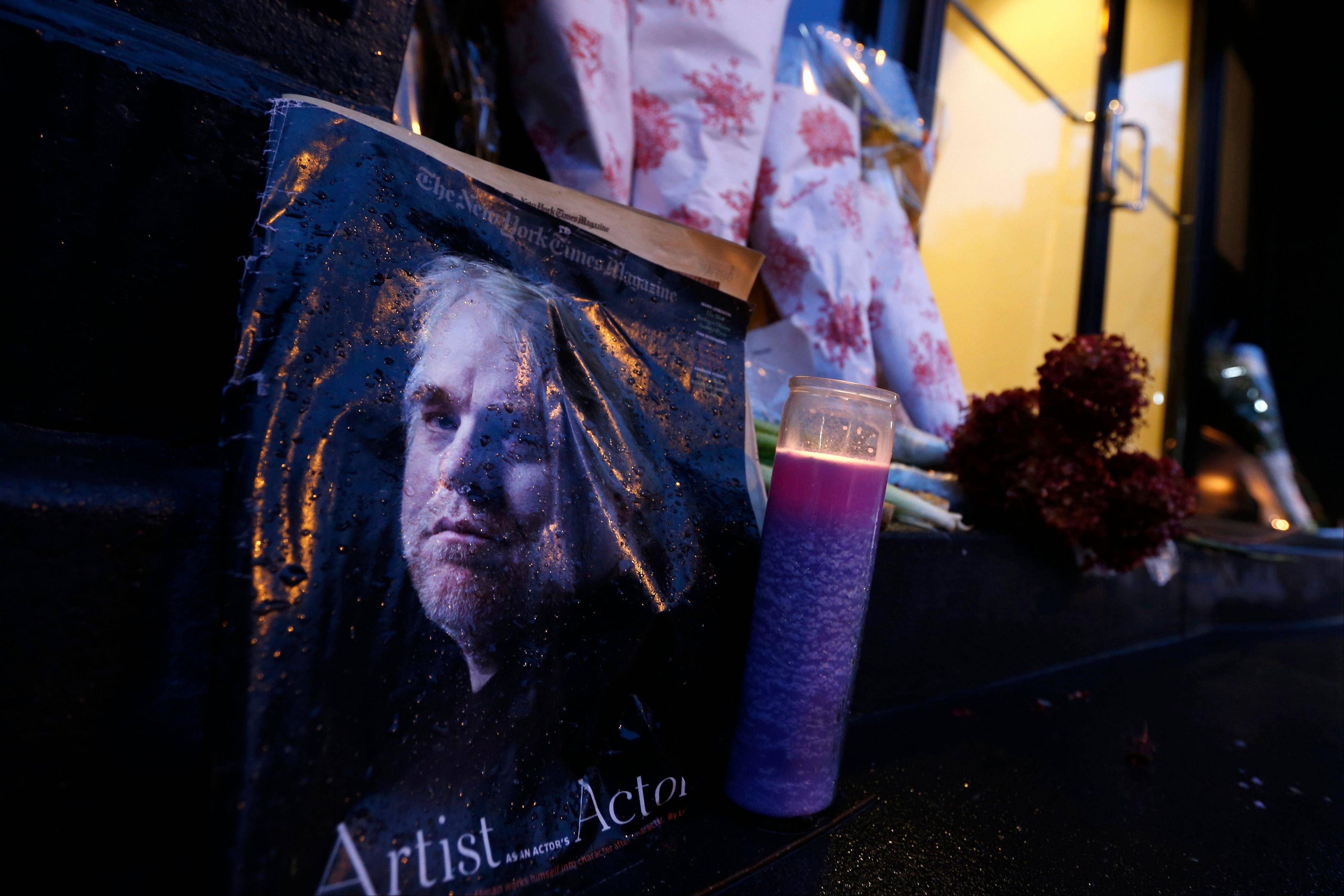 A makeshift memorial sits outside the home of actor Philip Seymour Hoffman, Monday, Feb. 3, 2014, in New York. Hoffman, 46, was found dead Sunday in his apartment of a suspected drug overdose.
