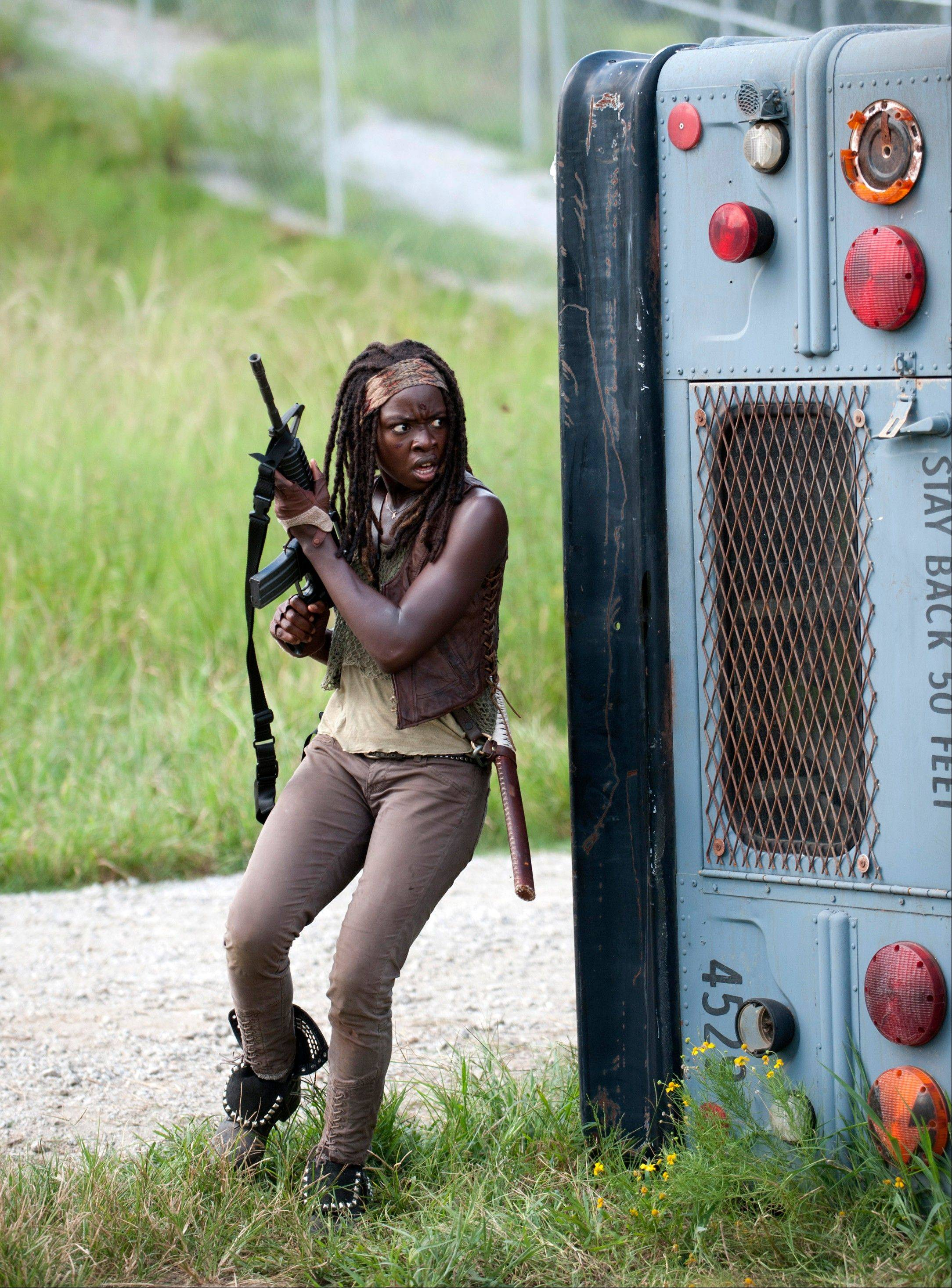 Danai Gurira hunts down invaders to their camp as Michonne in a scene from �The Walking Dead,� which resumes episodes from its fourth season on Feb. 9.
