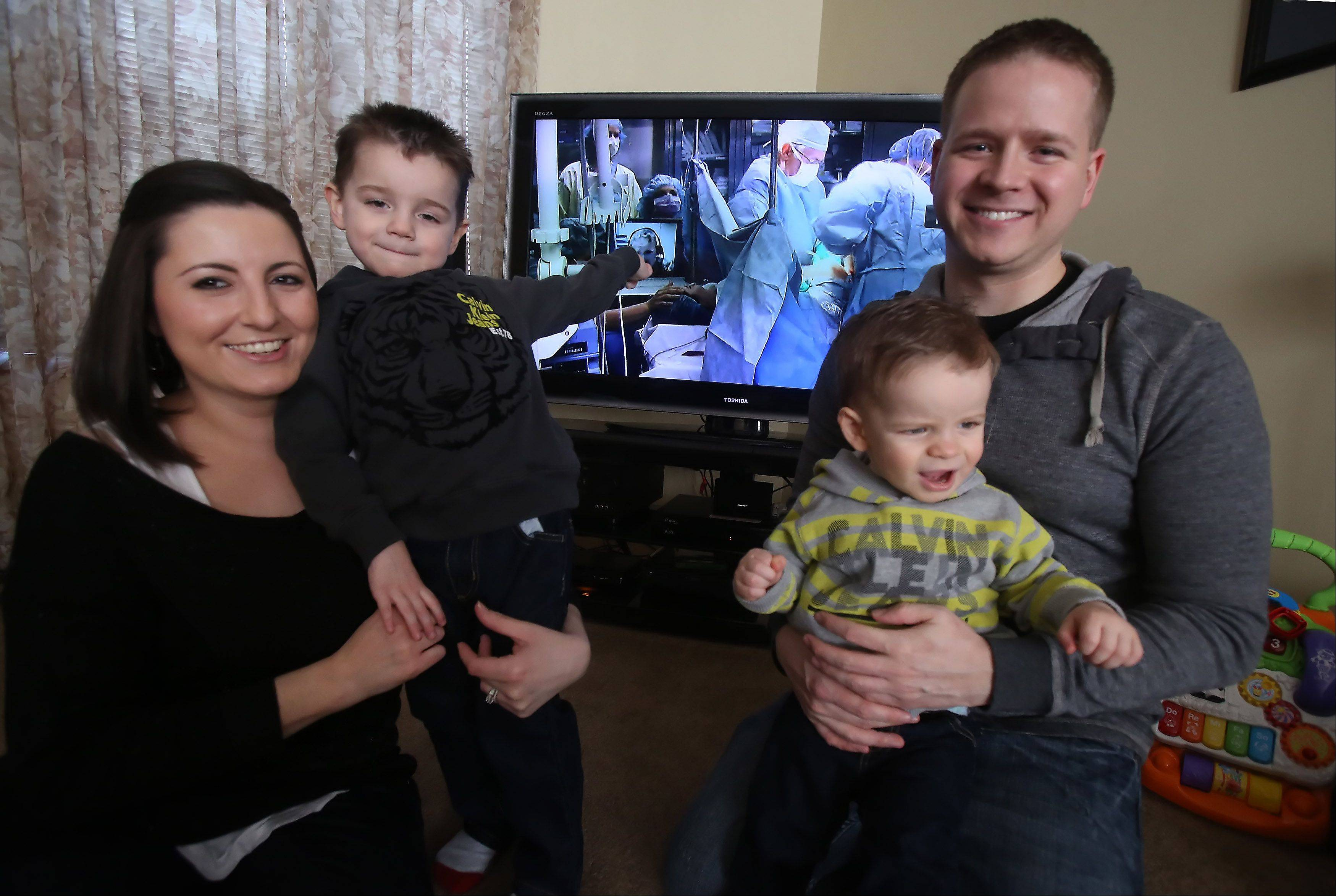 Bensenville residents Greg and Jennifer Bacon, with their sons, 3-year-old Dean, left, and 18-month-old Christopher, were featured in a Microsoft ad that aired Sunday night during the Super Bowl. The ad featured the birth of Dean as it was Skyped live to his dad more than 6,000 miles away at a military base in Iraq.