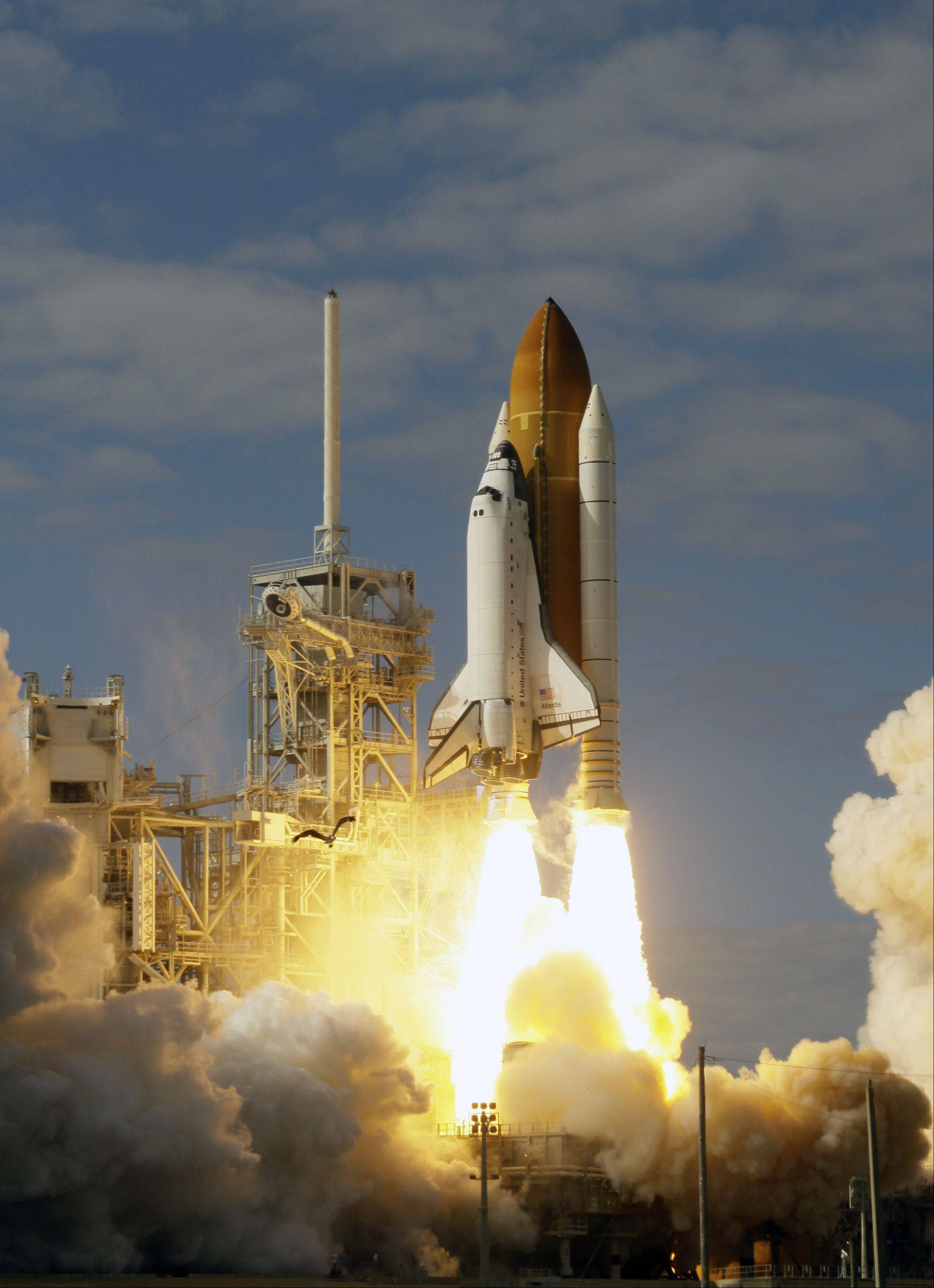 Space shuttle Atlantis lifts off from pad 39A at the Kennedy Space Center in Cape Canaveral, Fla. The Atlantis and Endeavor shuttles carried several experiments proposed by students into space, including ones intended to investigate the effects of microgravity on various organisms.