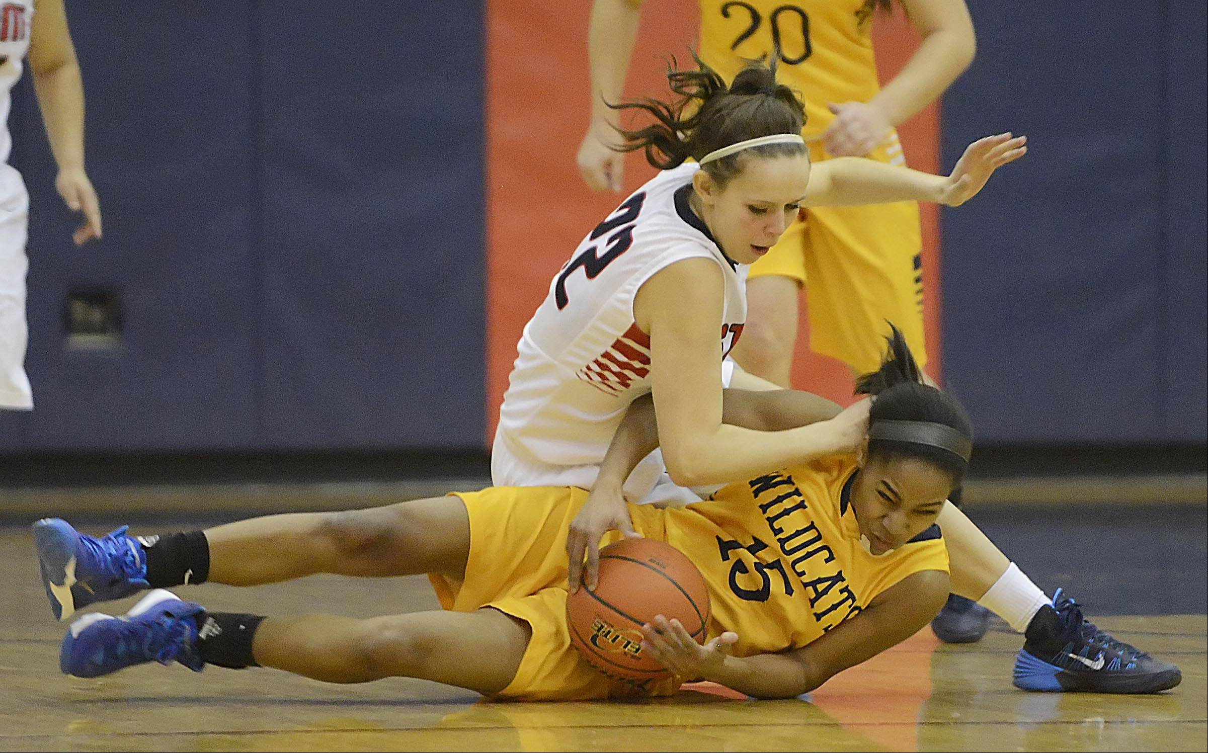 South Elgin�s Laura McIntosh falls over Neuqua Valley�s Malia Smith Monday as they chase a loose ball in South Elgin.
