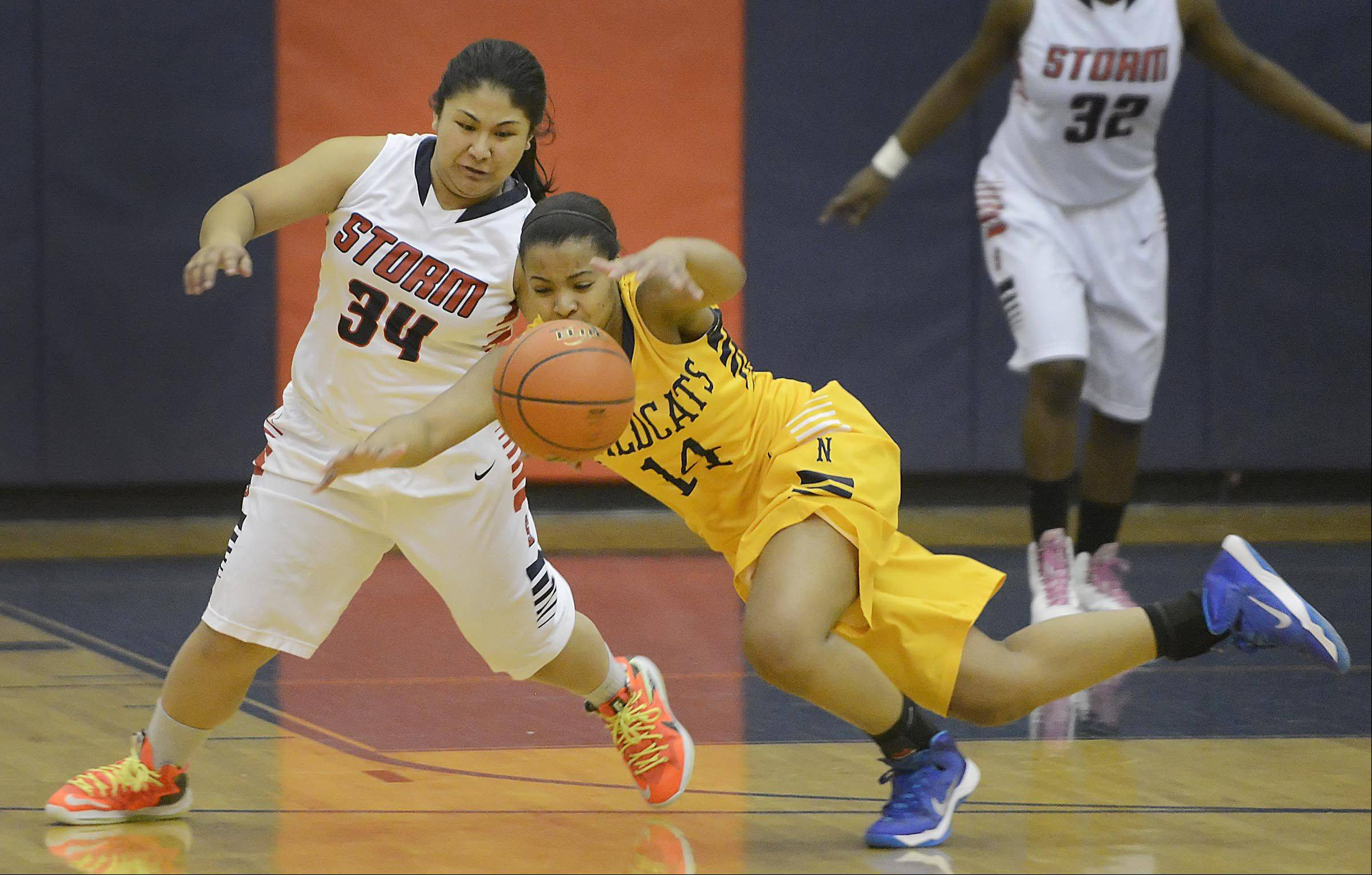 Neuqua Valley�s Najee Smith falls as South Elgin�s Nadia Yang defends.